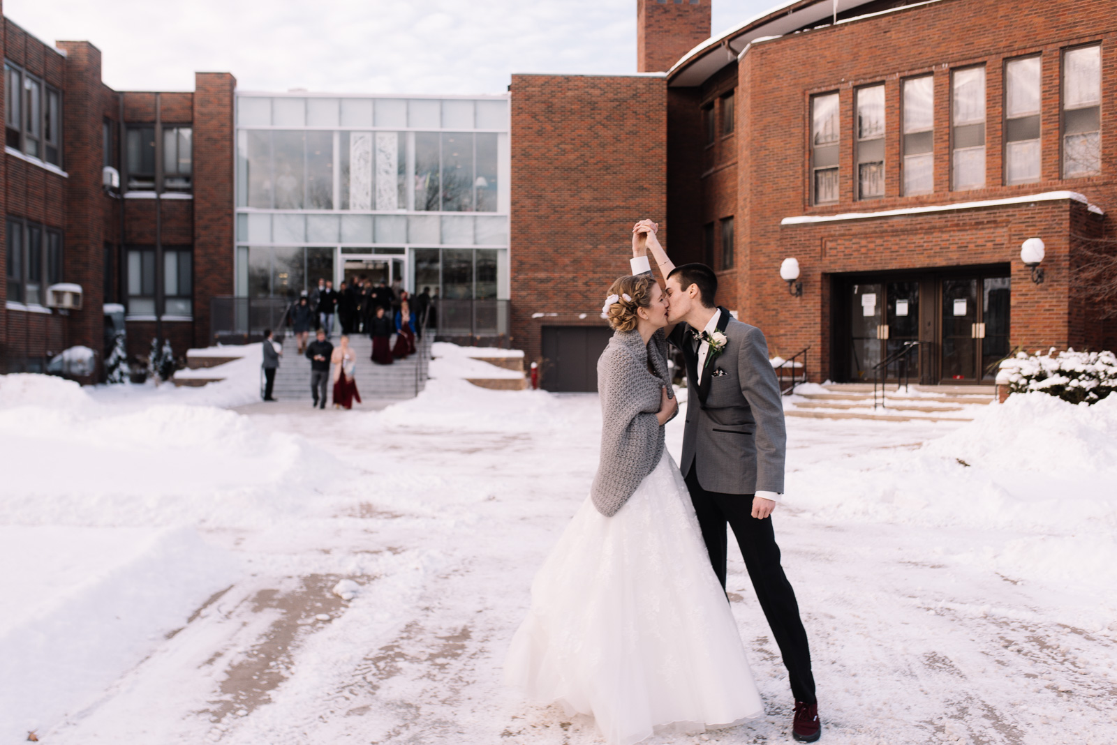 Bride and groom kissing outside St. Paul's United Methodist Church Winter Wedding