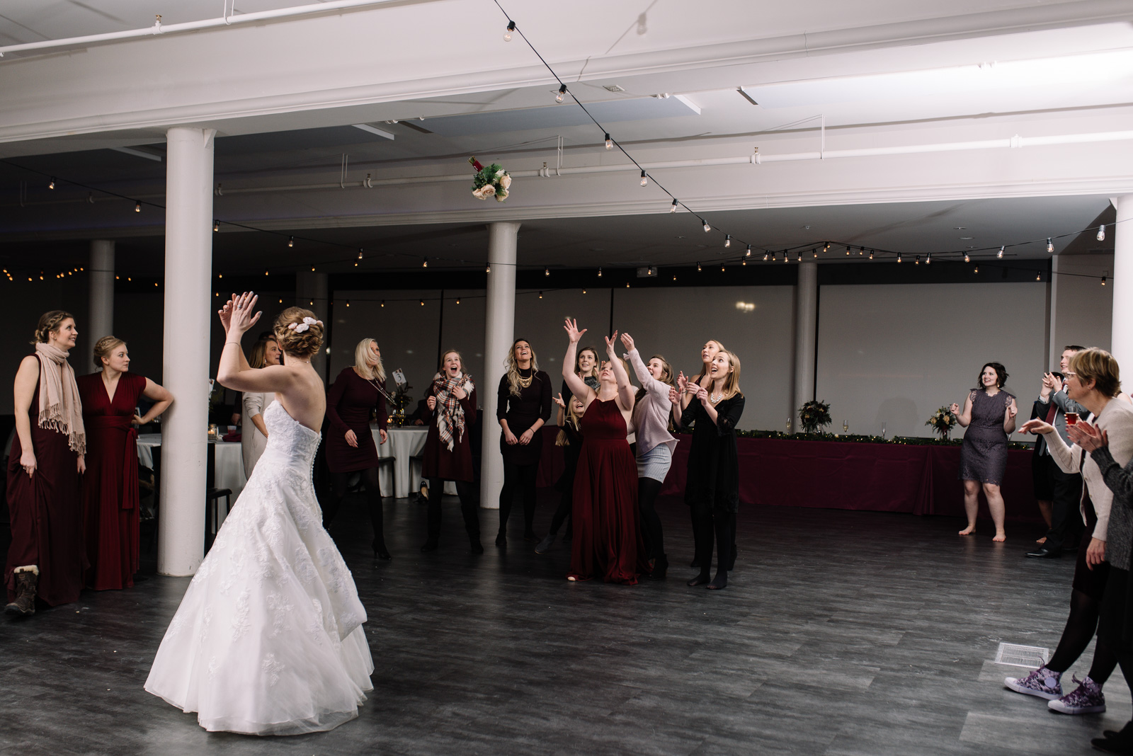 bouquet toss string lights eastbank wedding venue