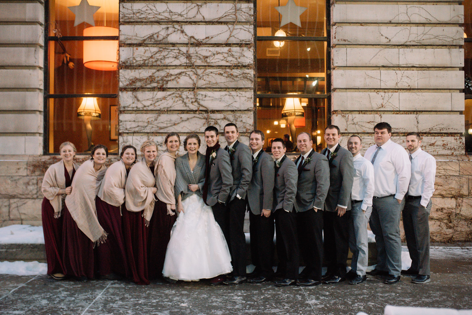 bridal party downtown cedar rapids winter wedding