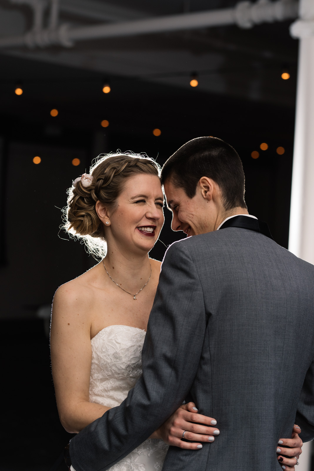 bride and groom first dance twinkly lights cedar rapids wedding