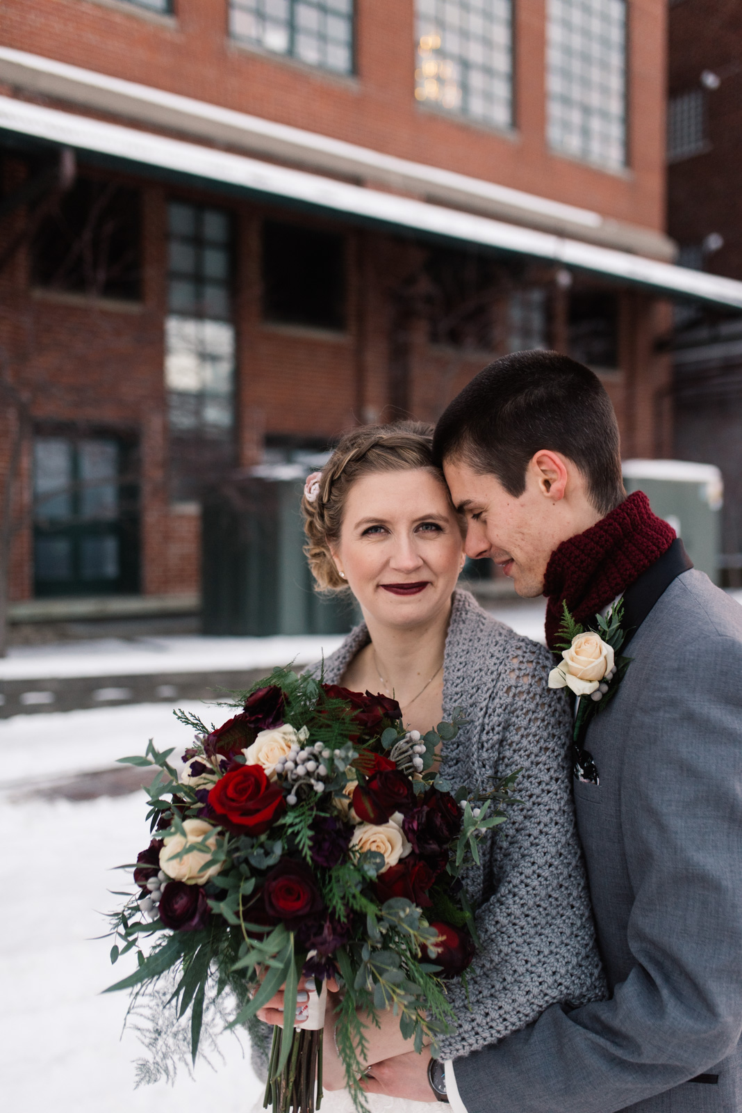 bride and groom holding bouquet iowa winter wedding