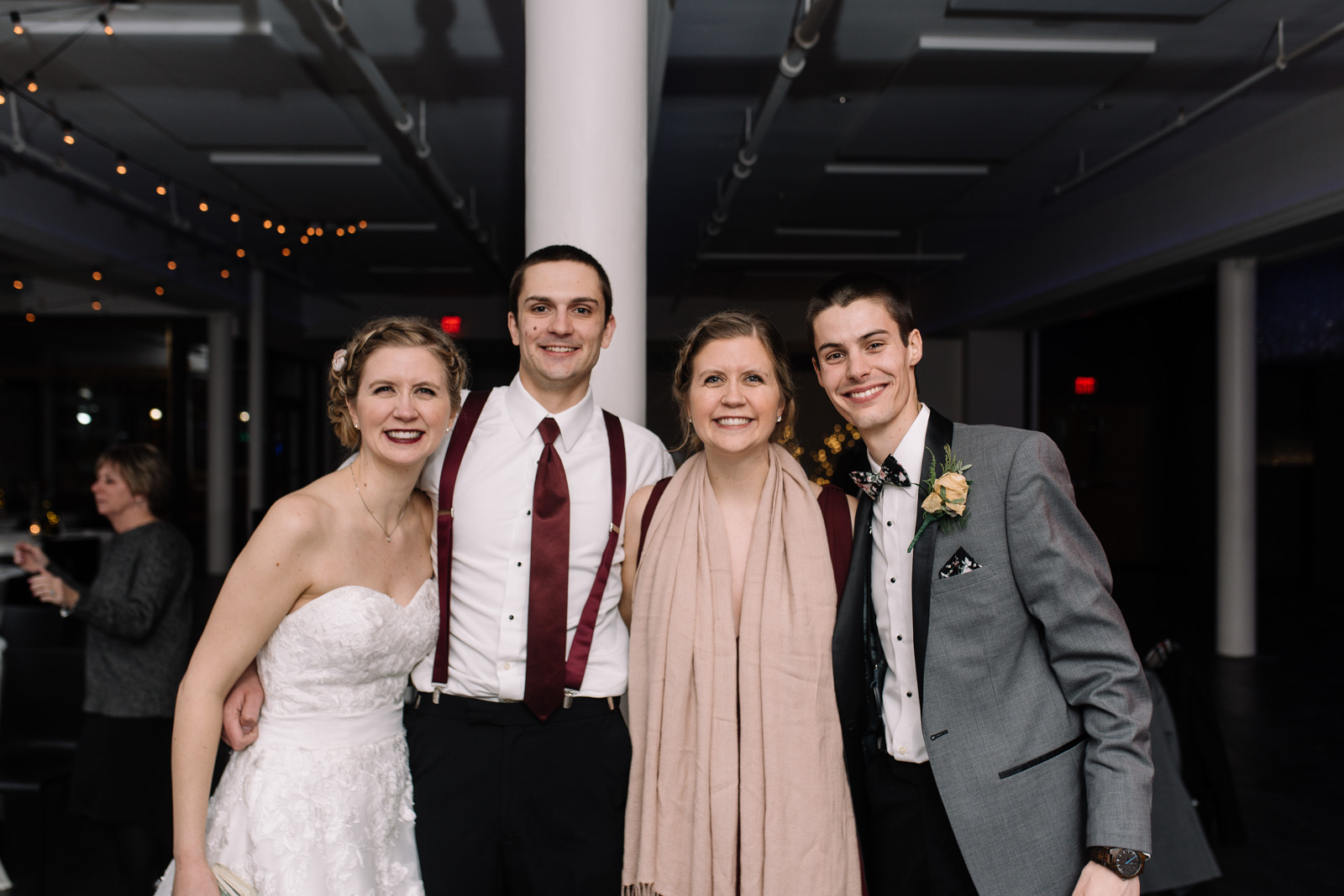 bride and groom with best man and maid of honor eastbank wedding venue