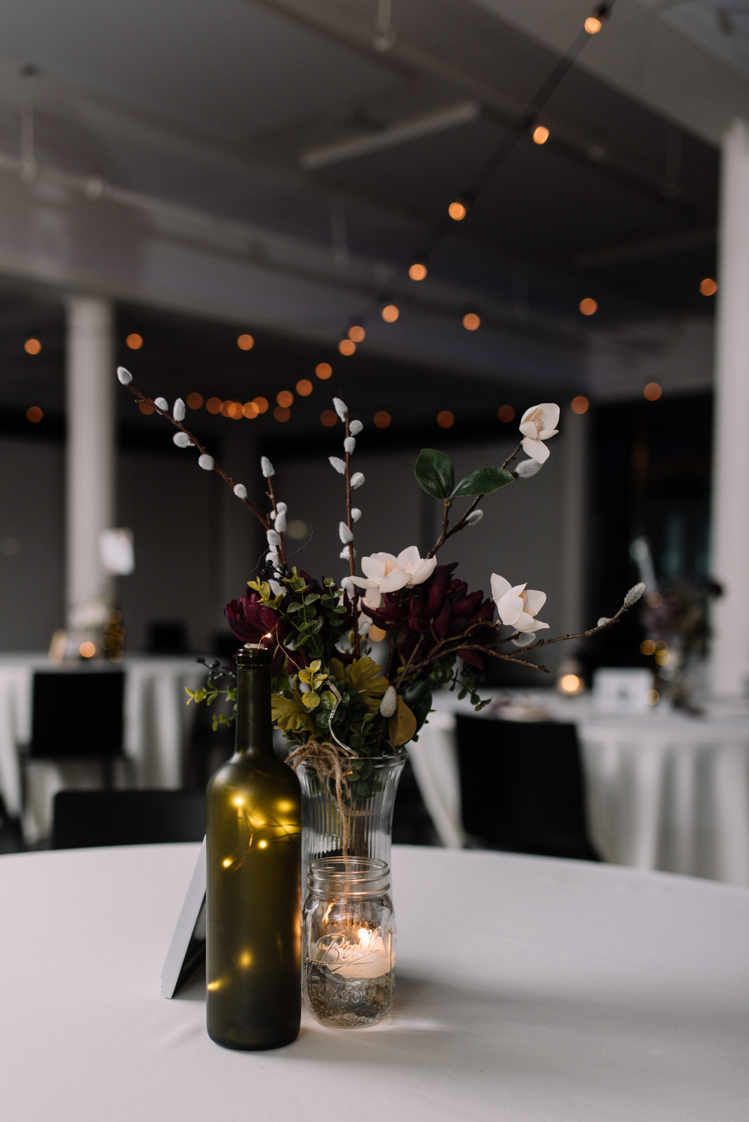 iowa winter wedding table decor string lighting eastbank wedding venue