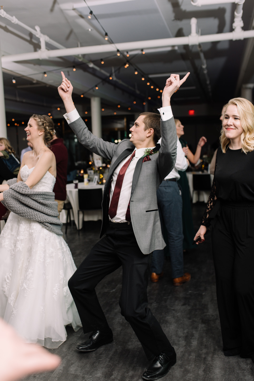 wedding guests dancing eastbank wedding venue bistro lights