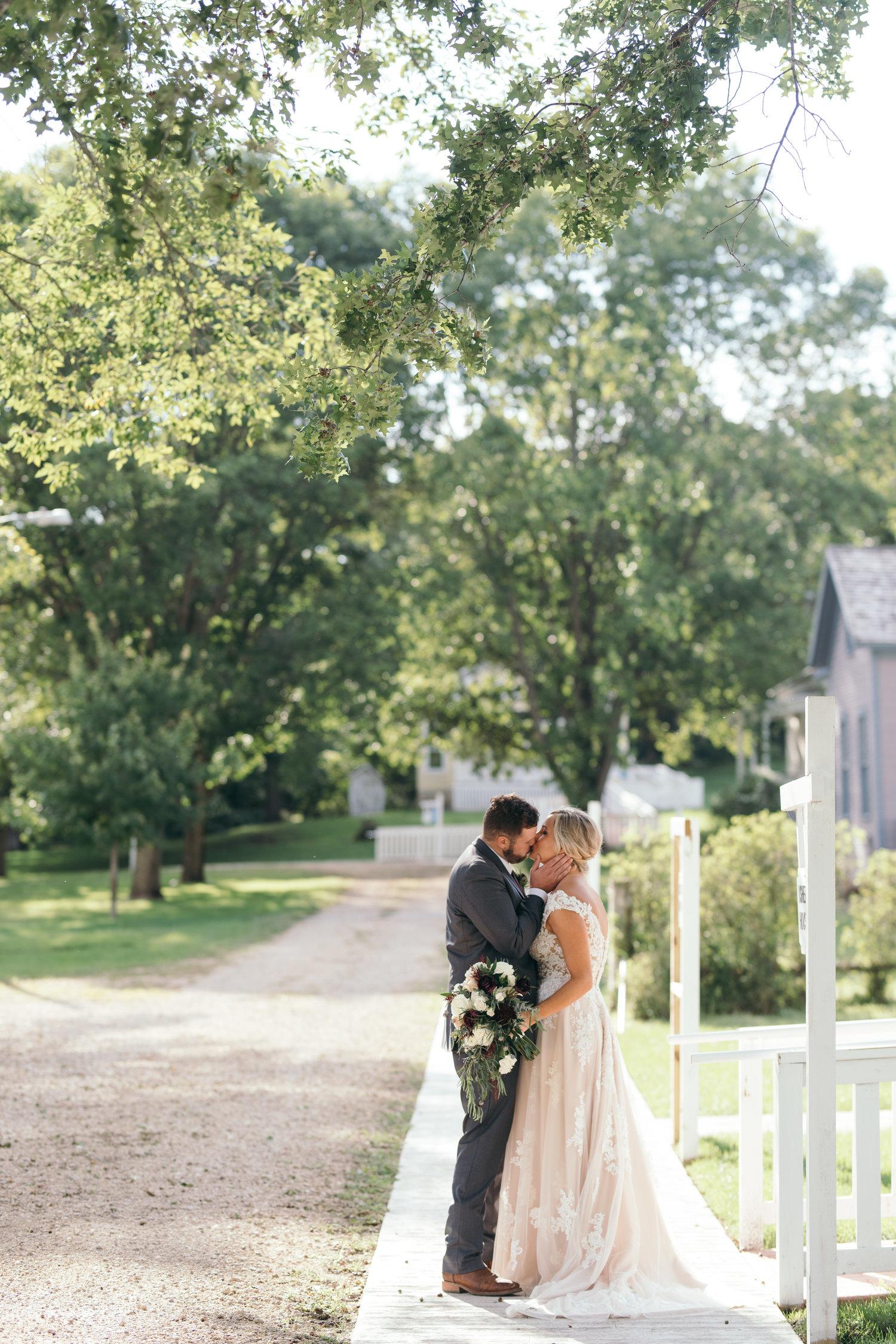 bride and groom kissing September wedding Ushers Ferry Historic Village wedding venue
