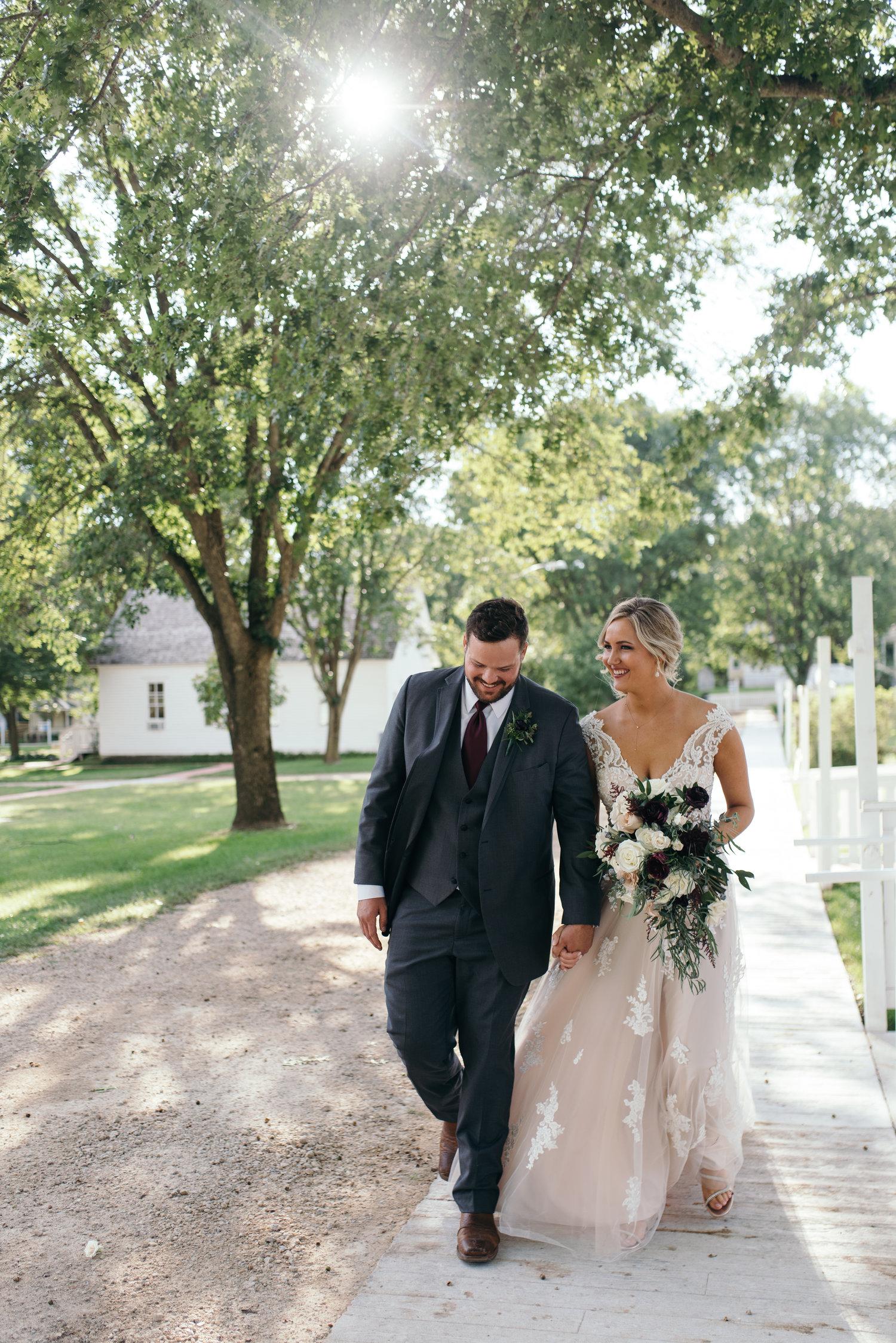 bride and groom walking Ushers Ferry Historic Village wedding venue sunset
