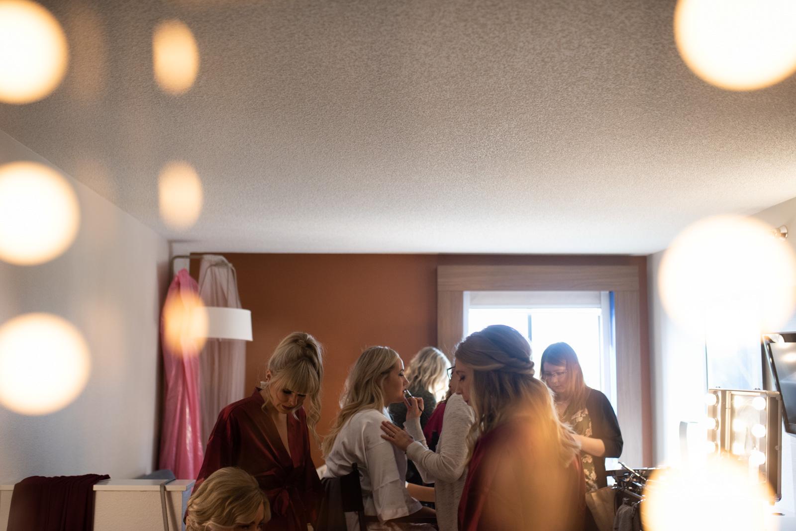 bride and bridesmaids getting makeup done cedar rapids marriott