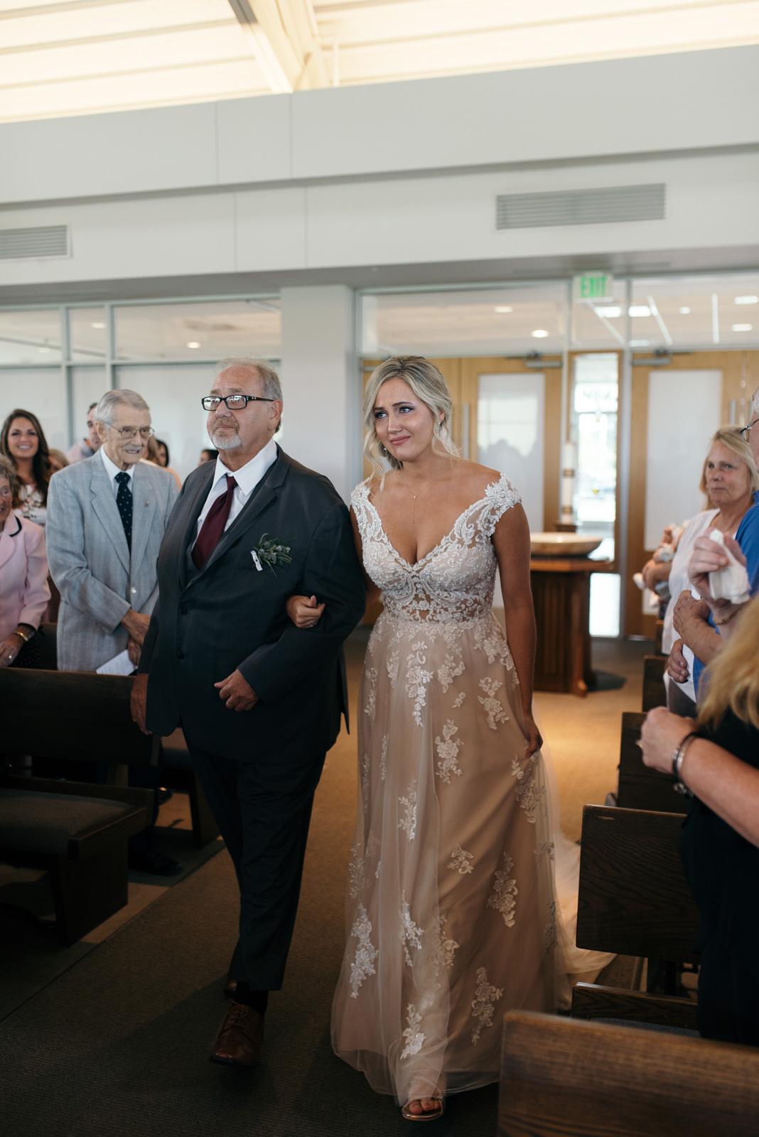 bride walking down aisle St. John XXIII Parish wedding ceremony