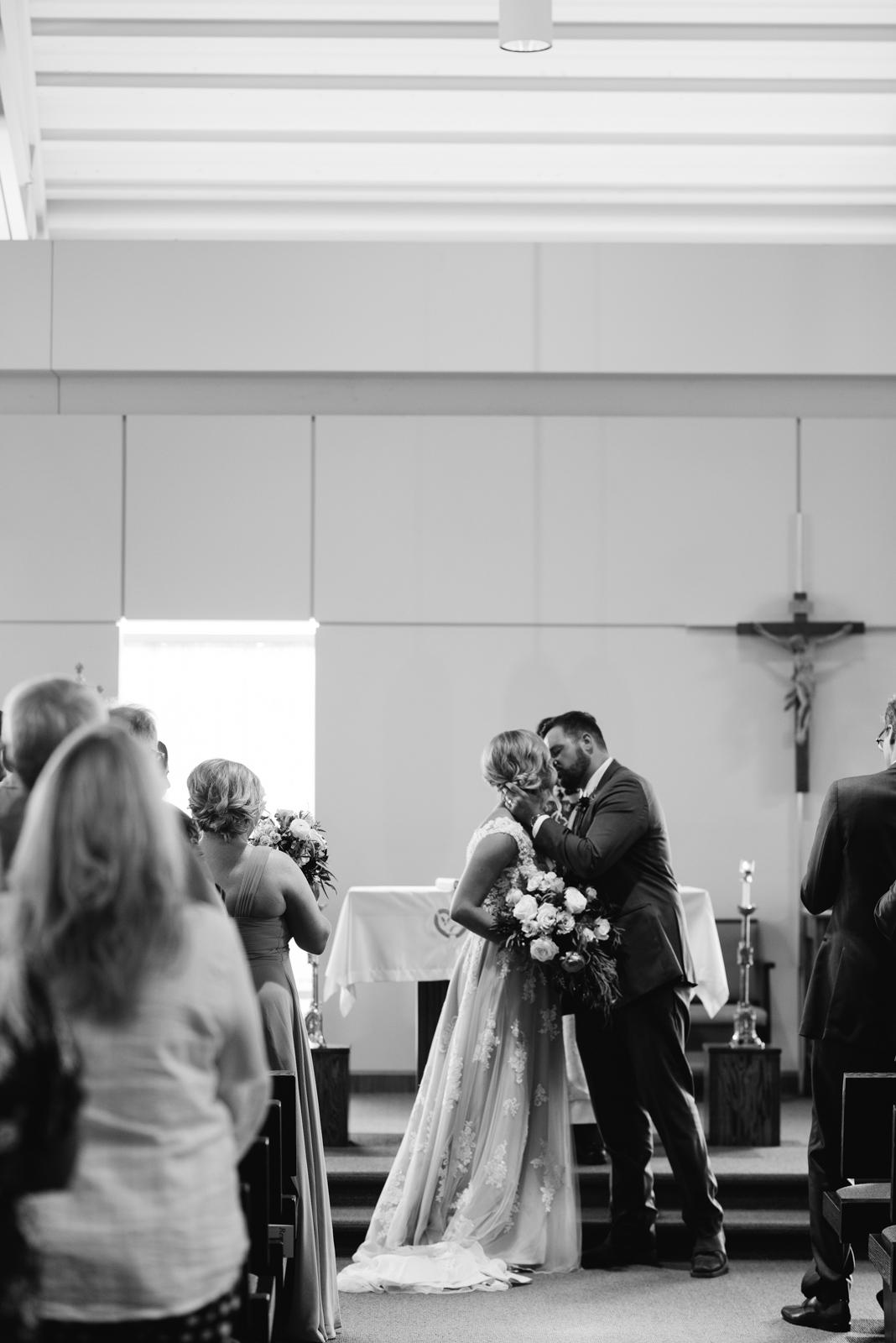 first kiss St. John XXIII Parish wedding