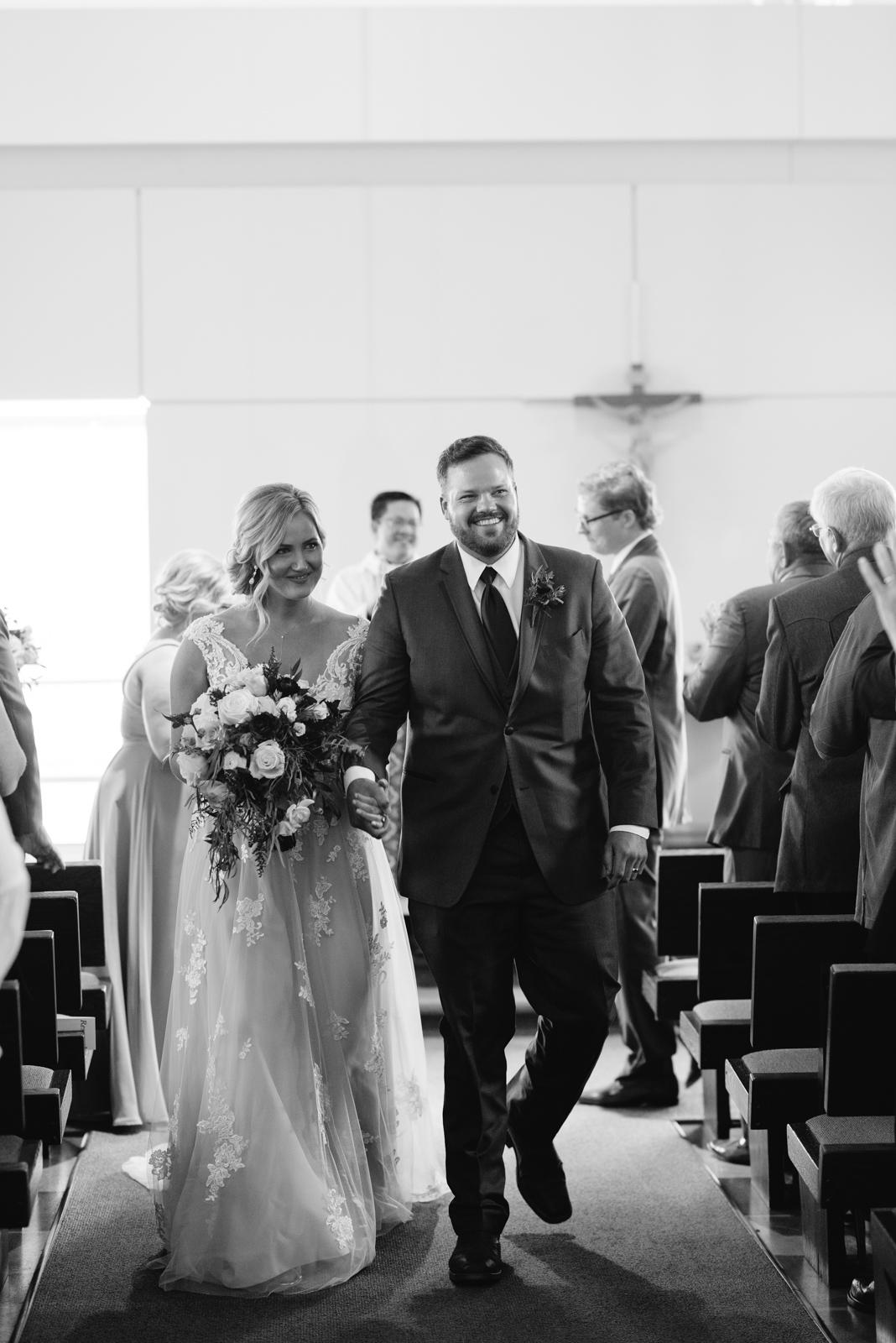bride and groom walking down aisle St. John XXIII Parish wedding ceremony