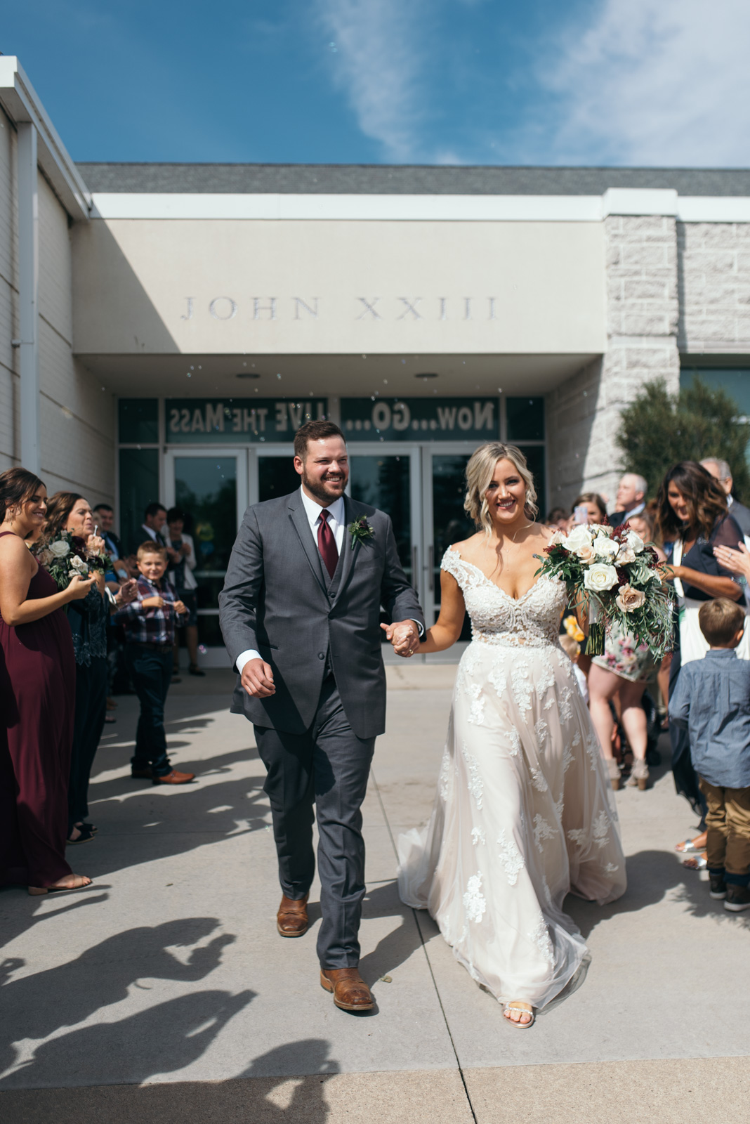 bubble exit St. John XXIII Parish cedar rapids wedding