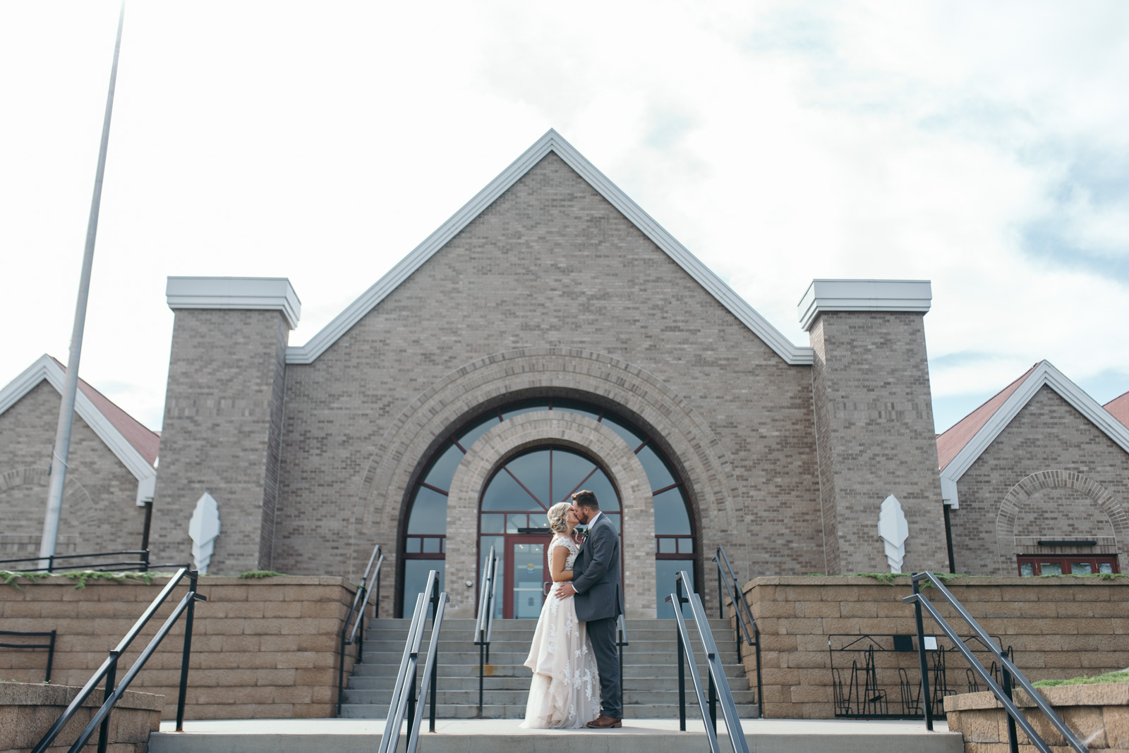 bride and groom kissing outside National Czech & Slovak Museum & Library wedding