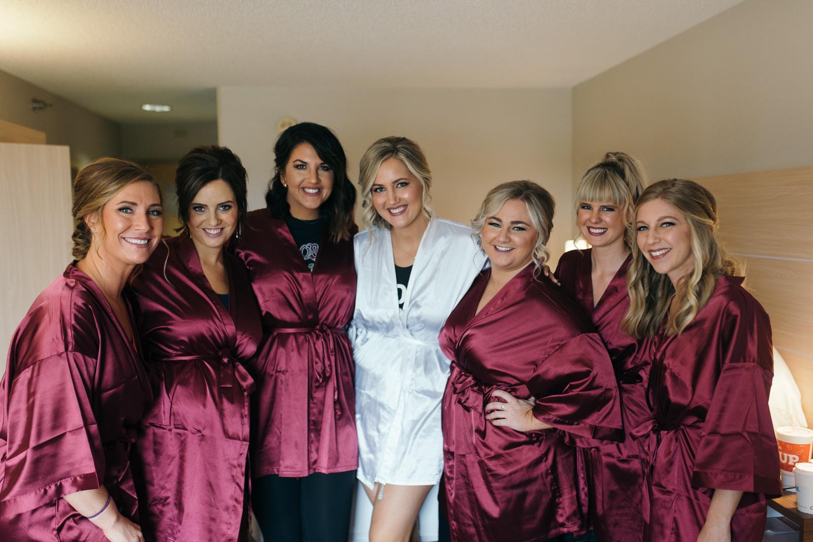 bride and bridesmaids in wedding robes