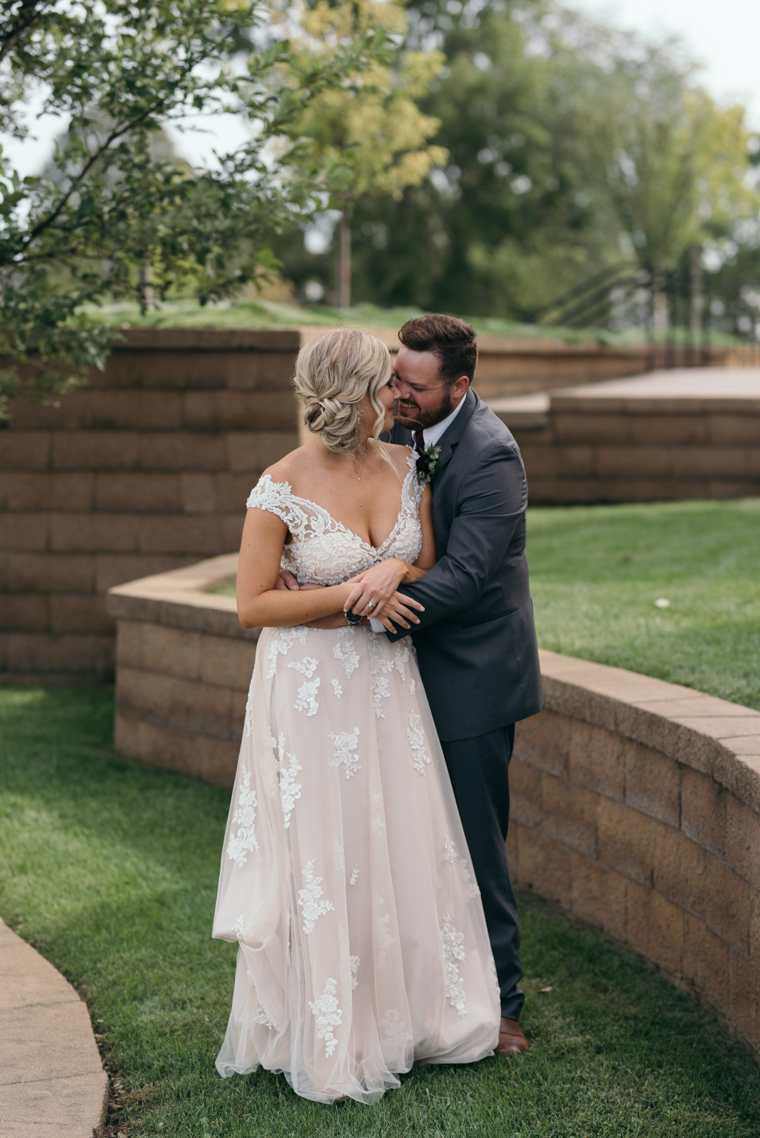 bride and groom cuddling outside cedar rapids wedding