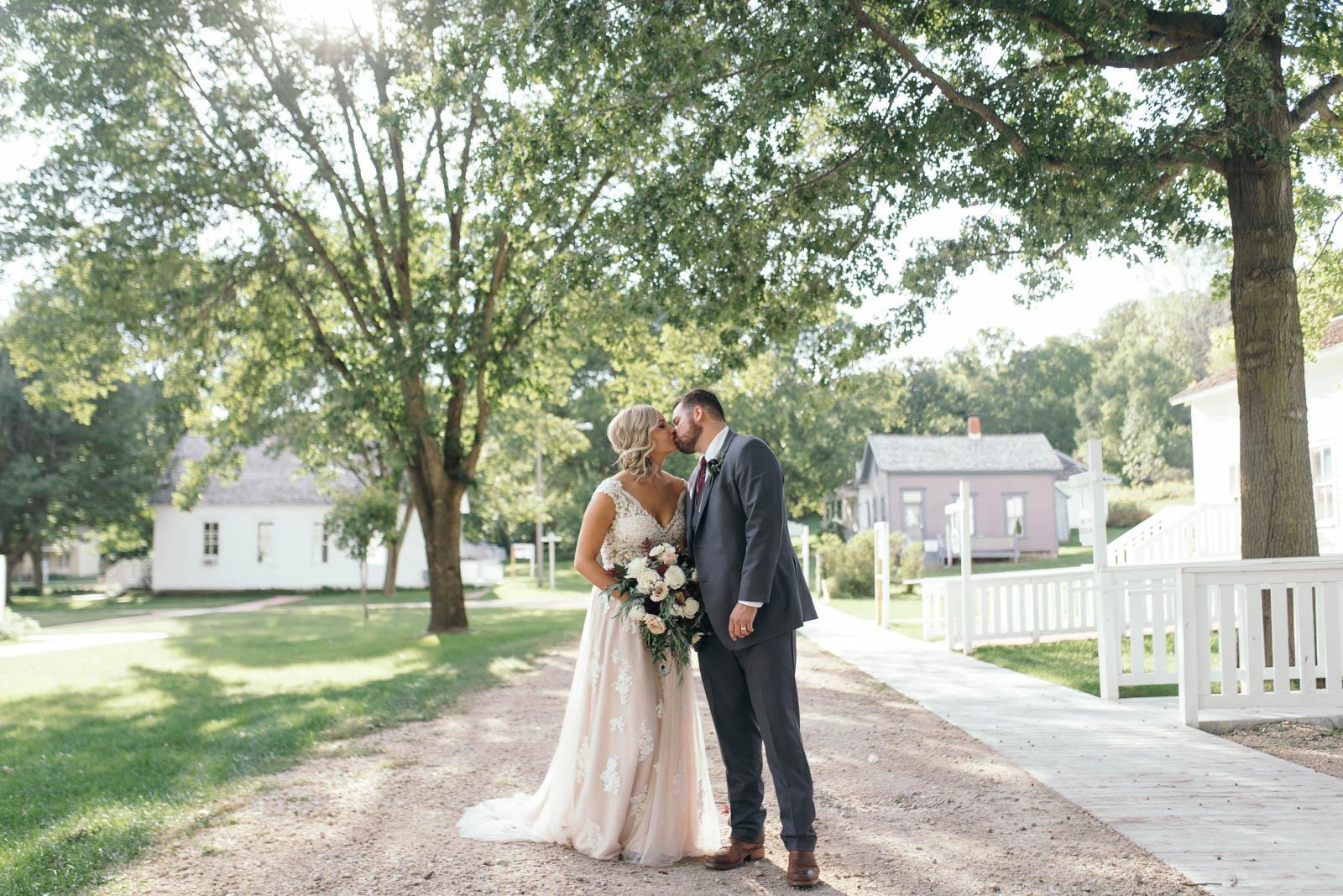 bride and groom kissing Ushers Ferry Historic Village wedding venue September