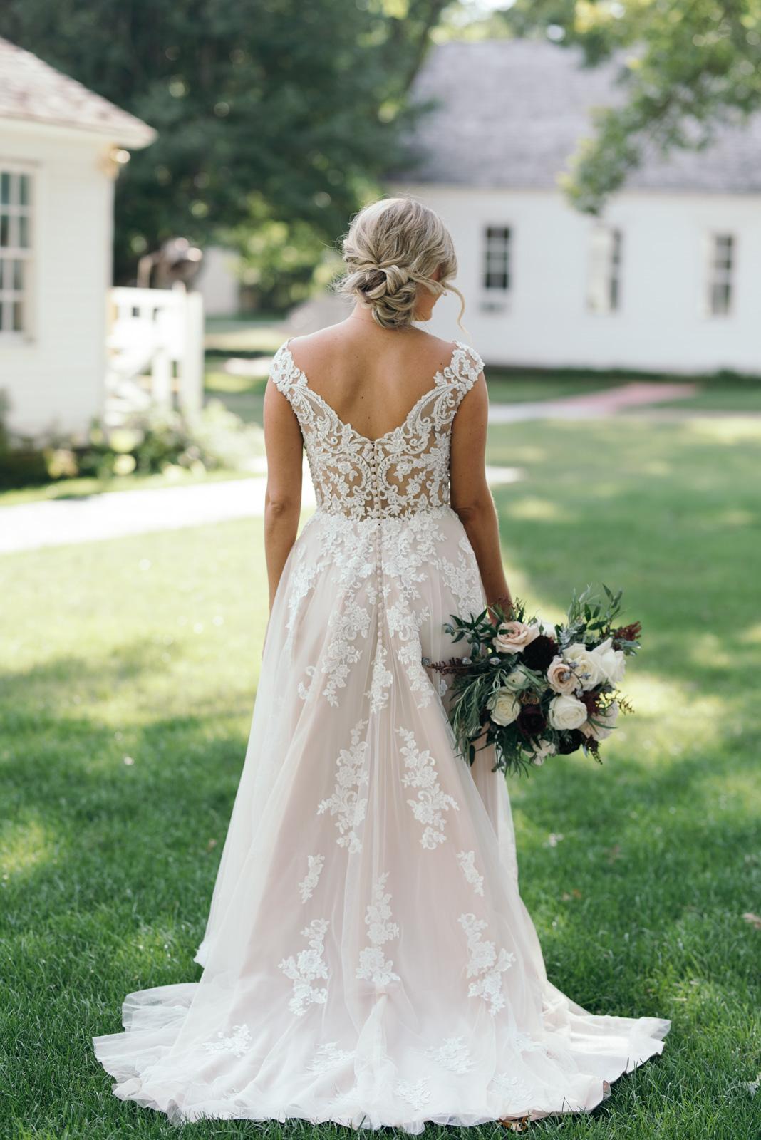 back of brides dress Ushers Ferry Historic Village wedding