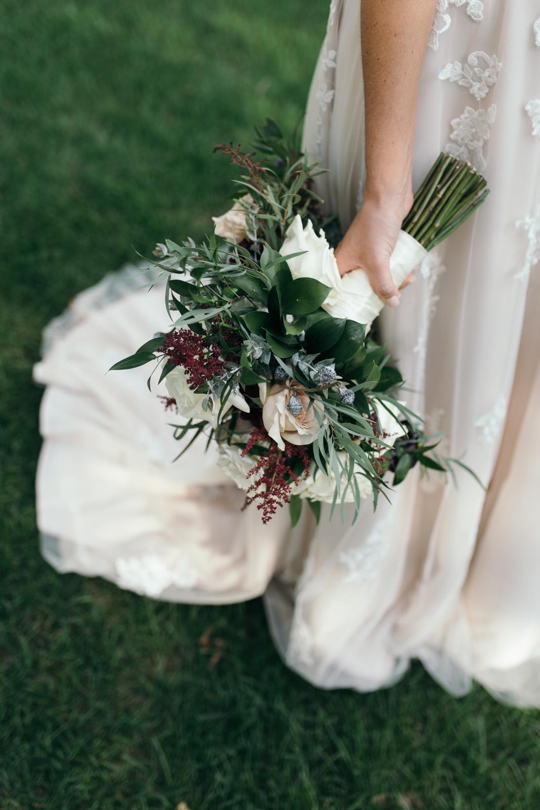 bride holding bridal floral bouquet