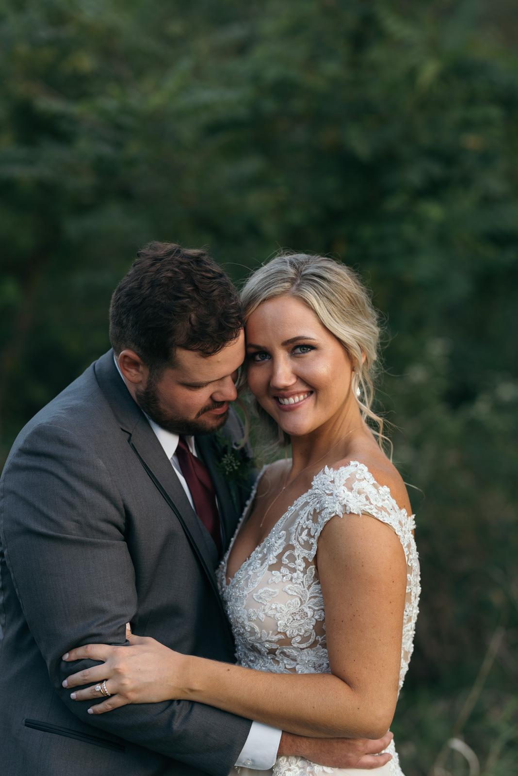 bride and groom cuddling cedar rapids wedding