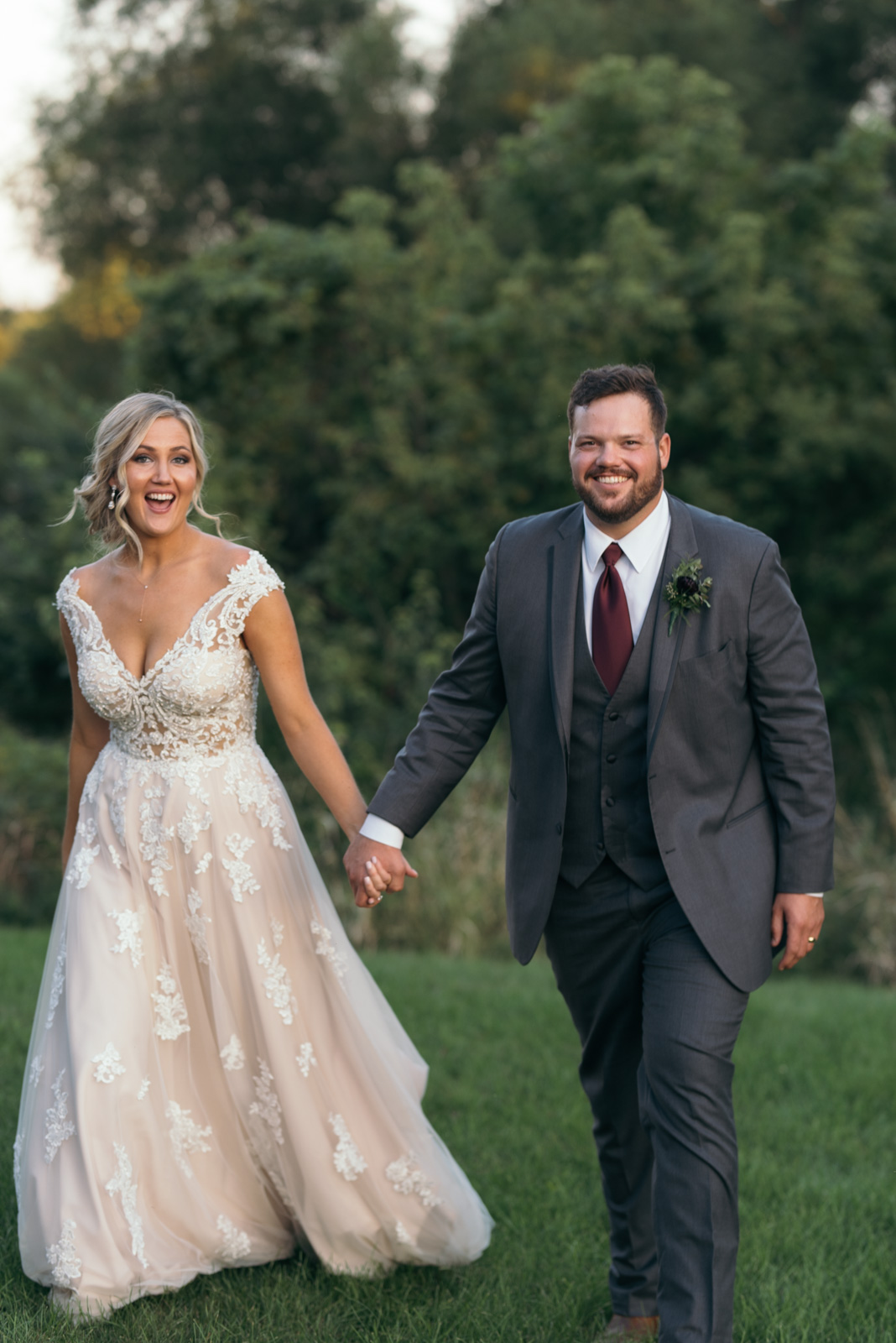 bride and groom holding hands cedar rapids wedding