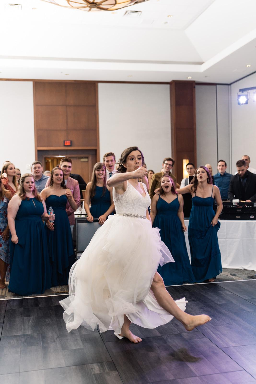 bride in epic dance battle Coralville Marriott Hotel wedding