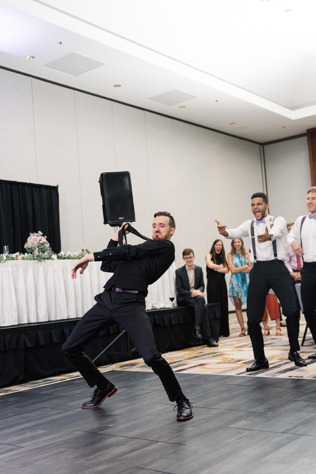 groom in epic dance battle Coralville Marriott Hotel wedding venue