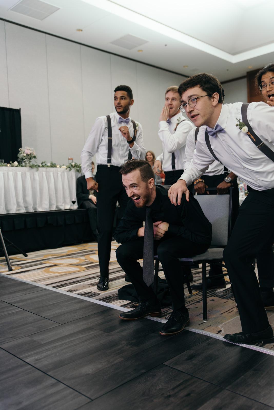 groom at Coralville Marriott Hotel wedding reception