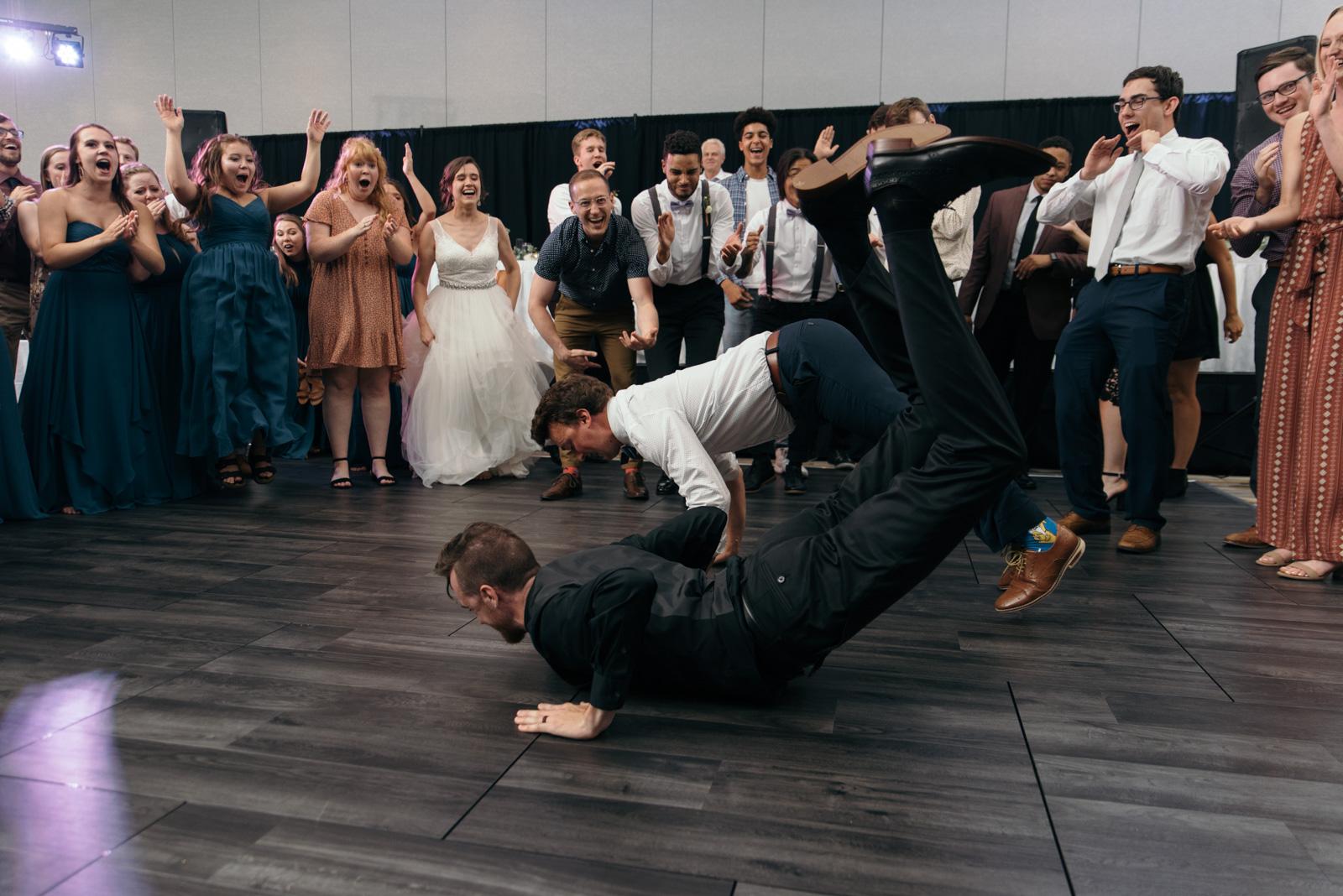 groom and groomsmen dancing coralville wedding reception
