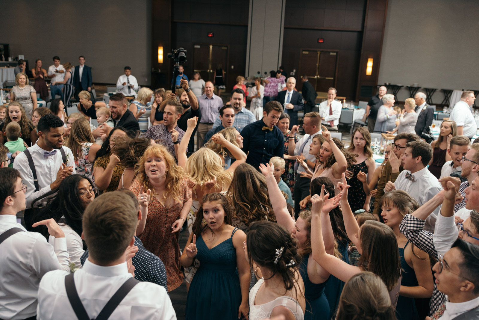 wedding guests dancing at Coralville Marriott Hotel wedding recepition