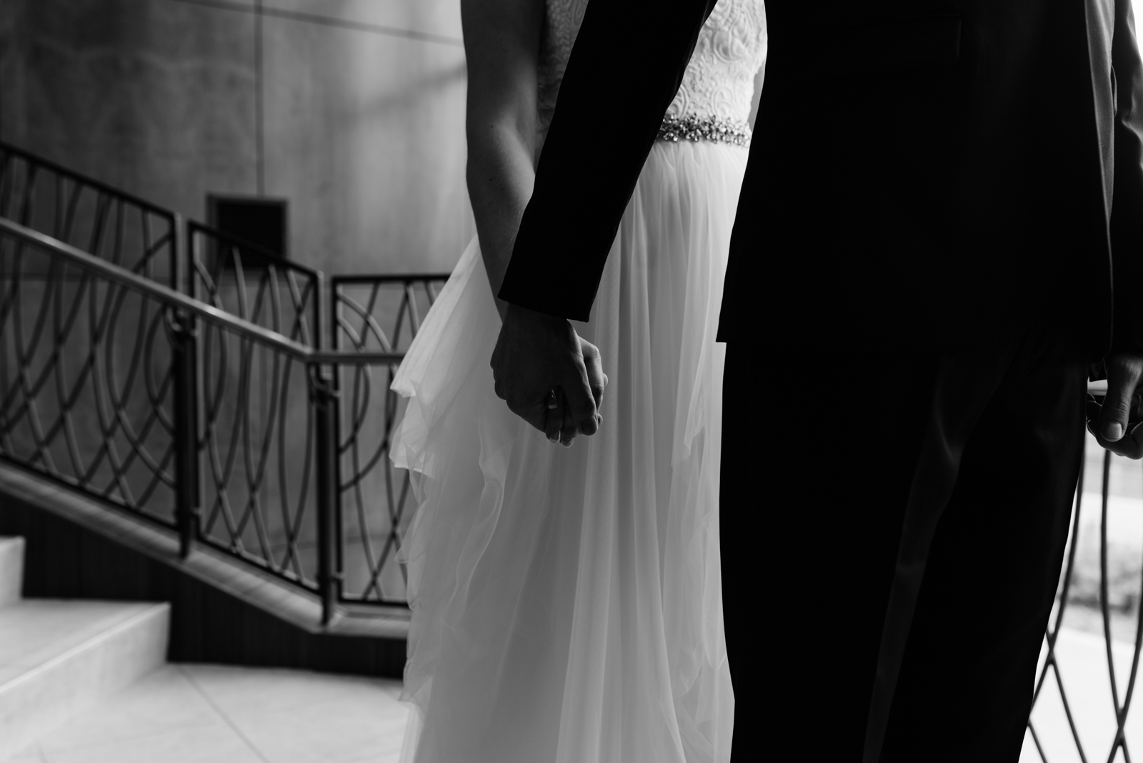 bride and groom holding hands first look Coralville Marriott Hotel Wedding