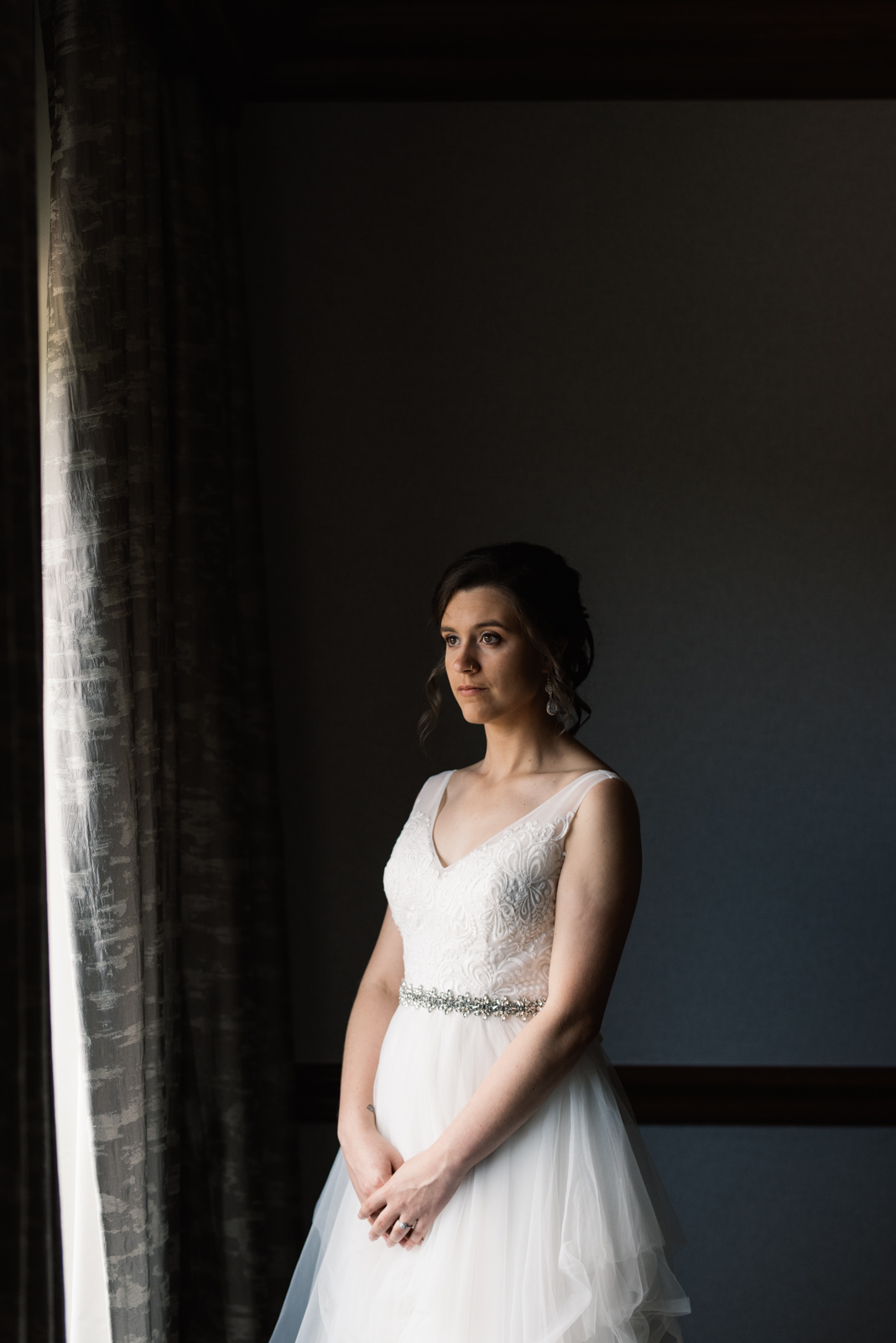 bride in window Coralville Iowa August Wedding