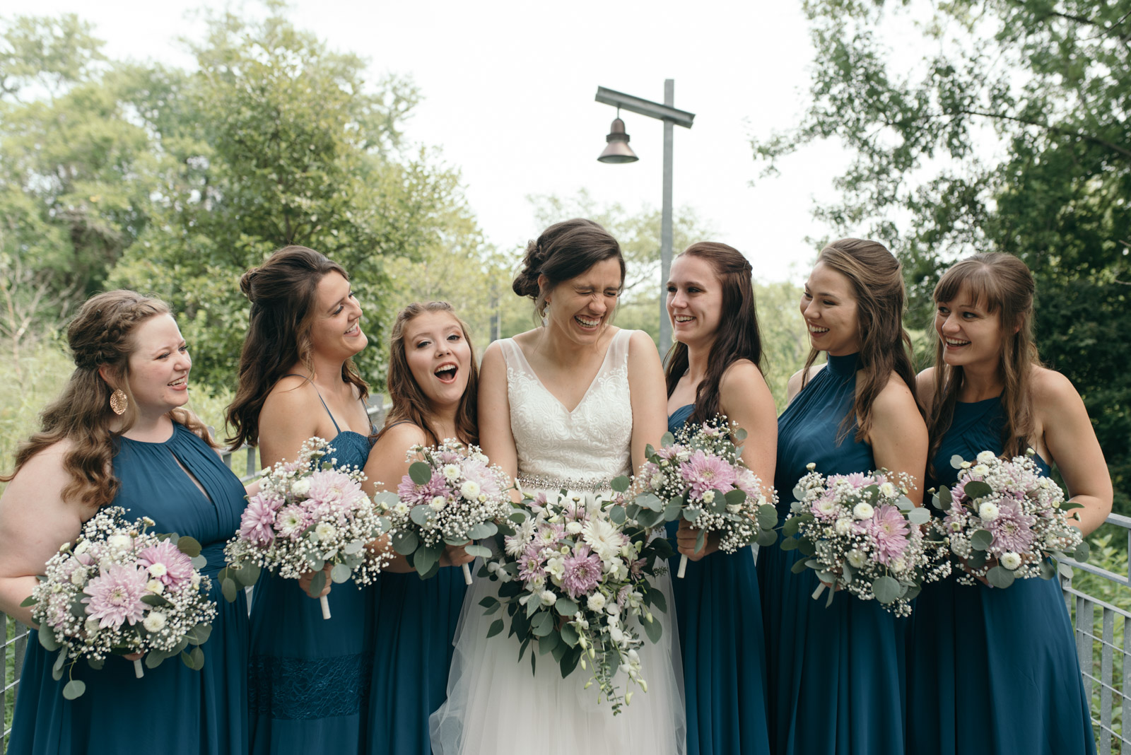 bride with bridesmaids at Coralville Marriott Hotel Wedding