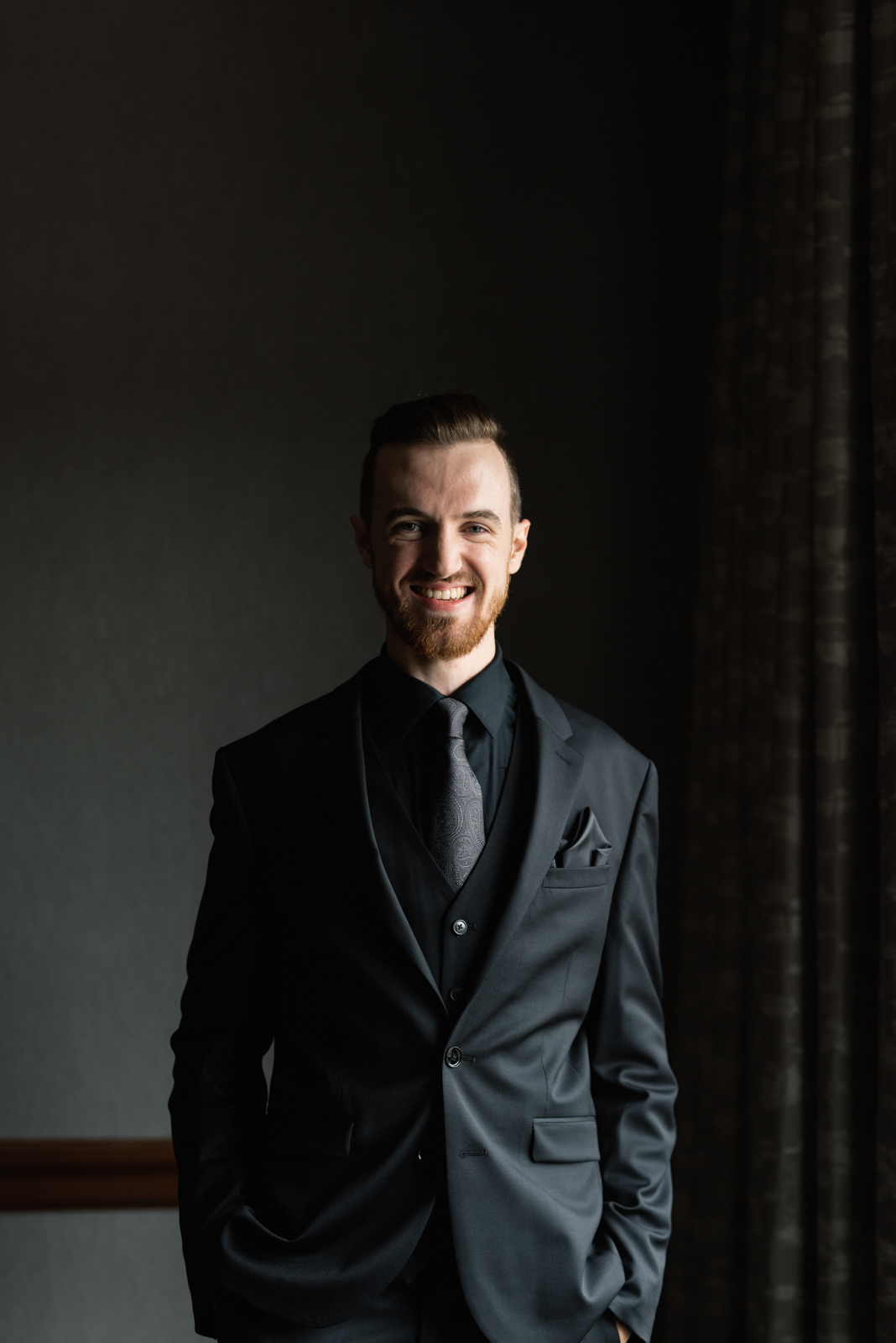 groom smiling august Iowa wedding