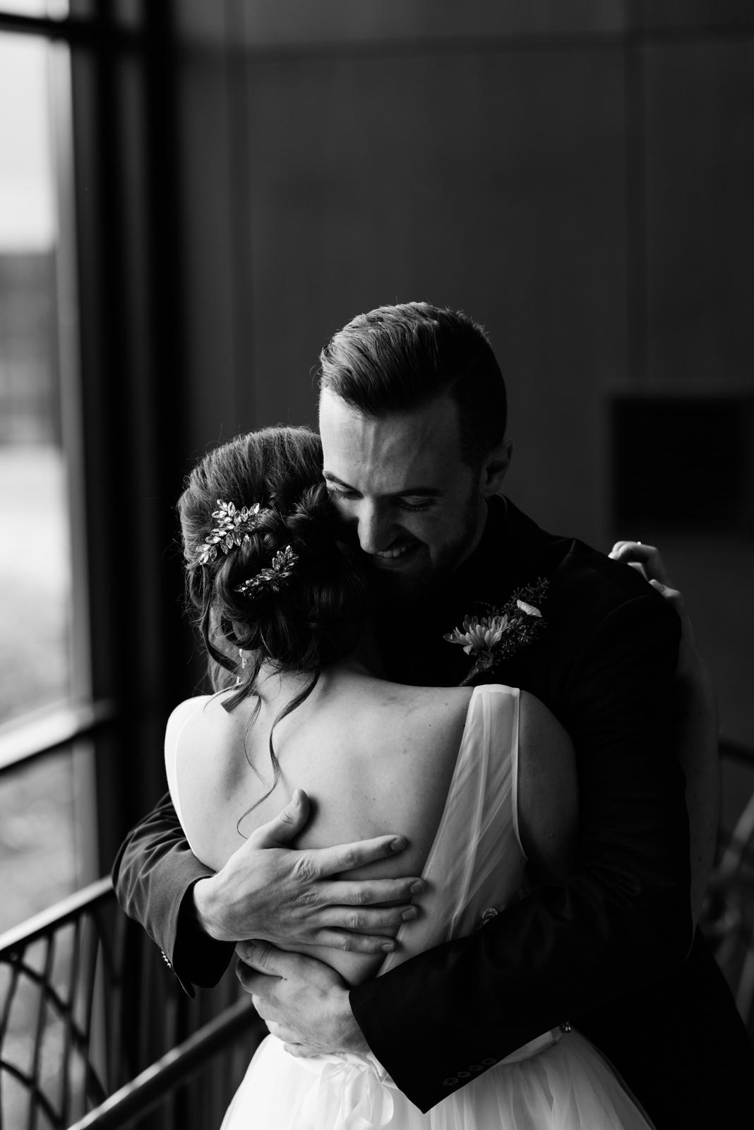 bride and groom hugging Coralville Marriott Hotel Wedding Venue