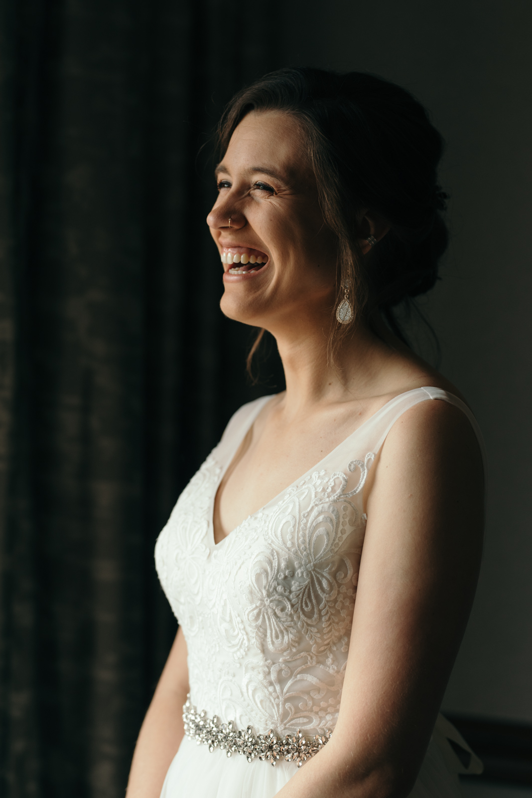 bride laughing Coralville Marriott Hotel Wedding