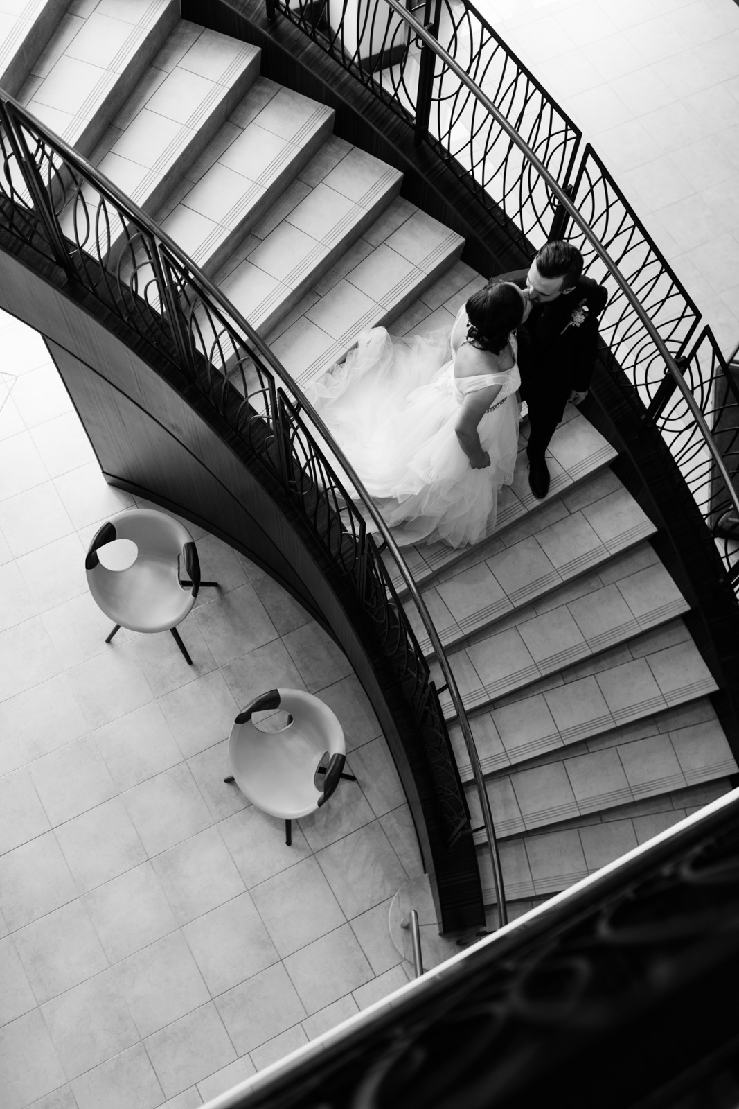 bride and groom on staircase at Coralville Marriott Hotel Wedding