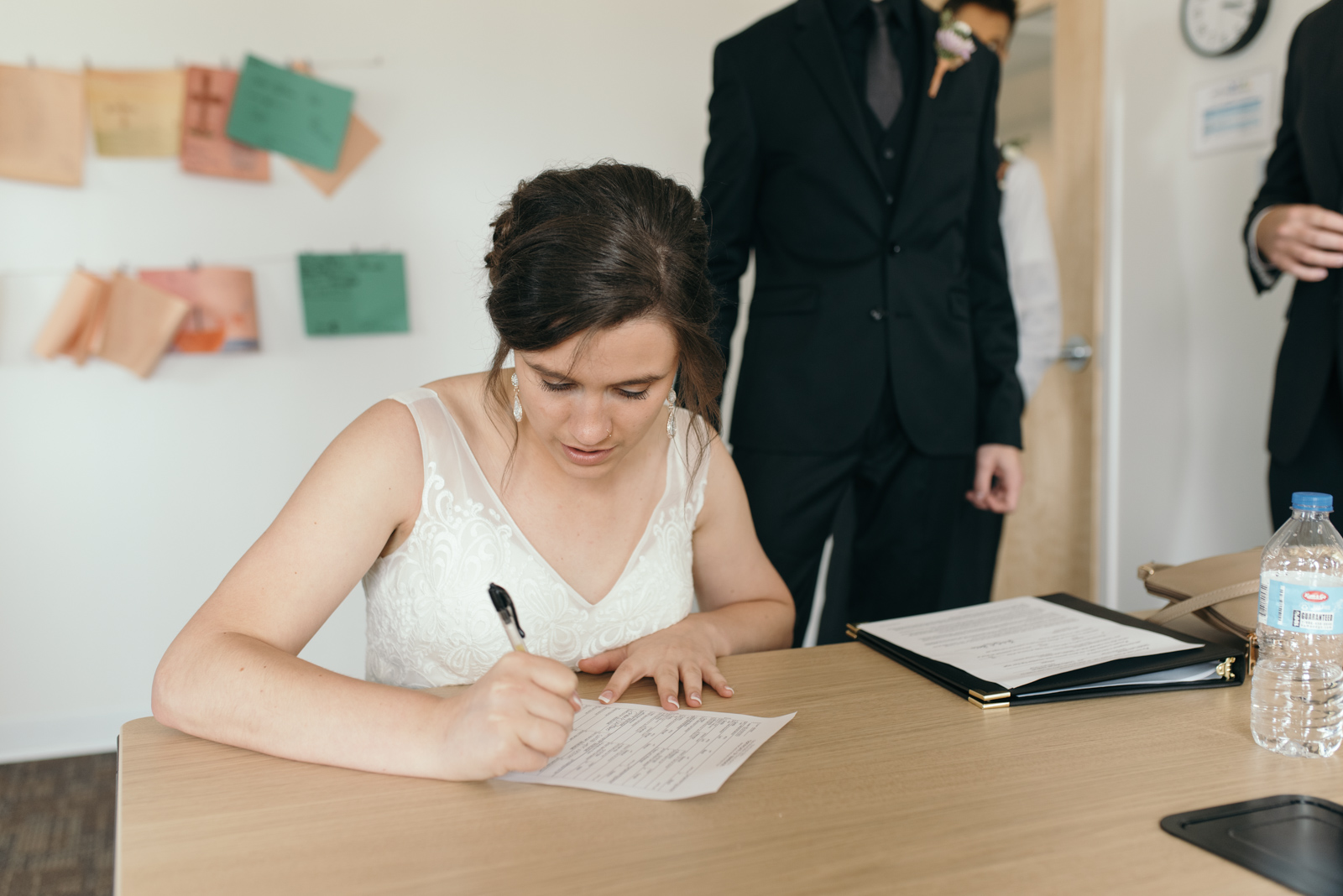 bride signing marriage license Iowa wedding