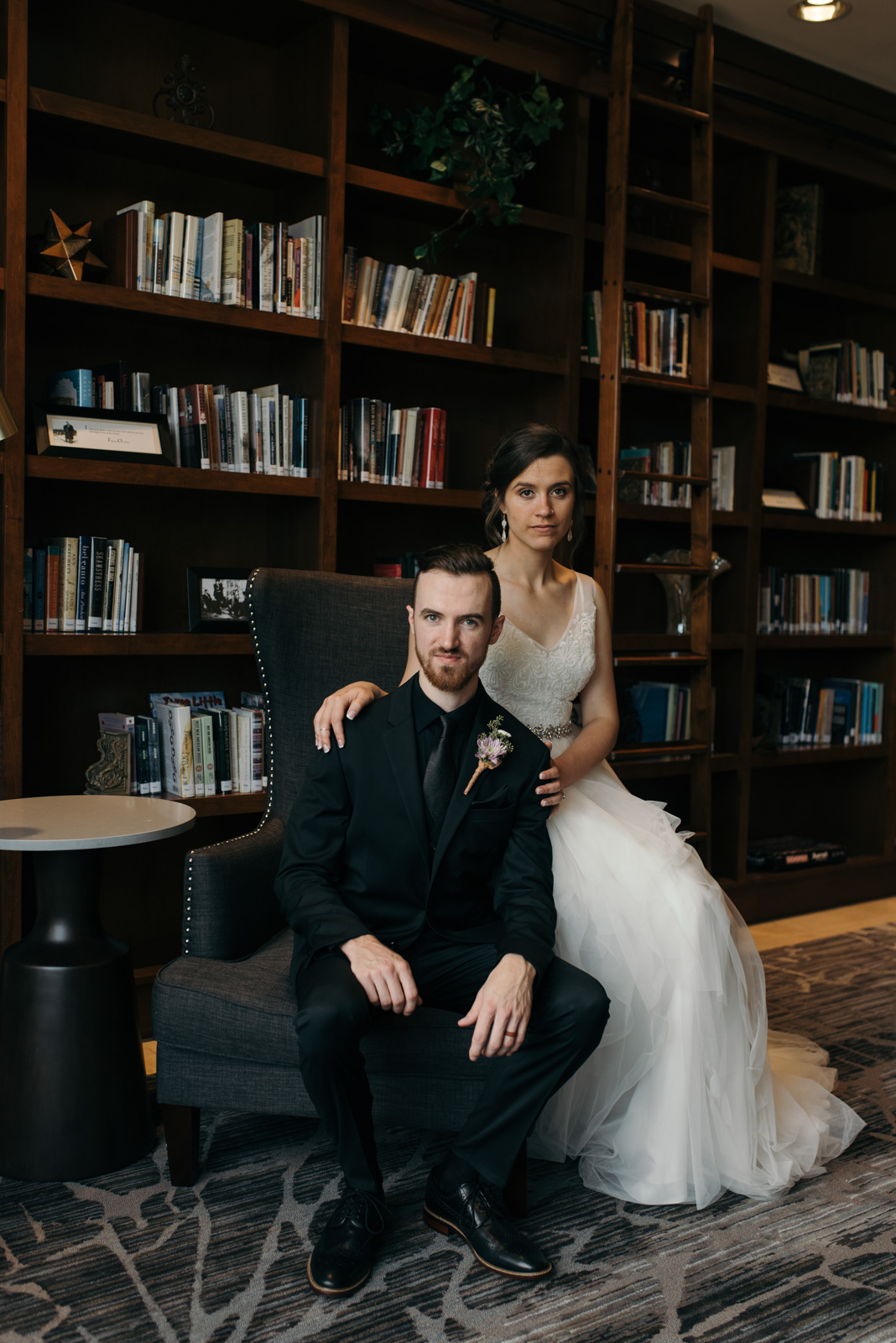 bride and groom in library Coralville Marriott Hotel Wedding
