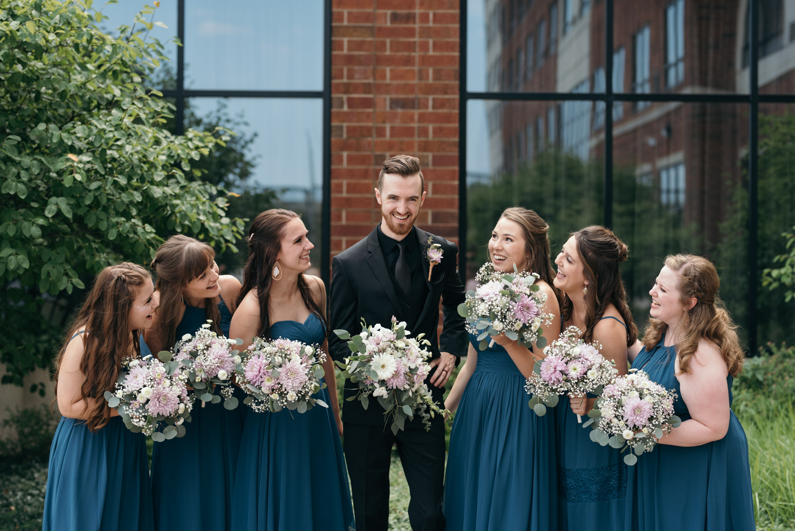 groom with bridesmaids Coralville Iowa august wedding