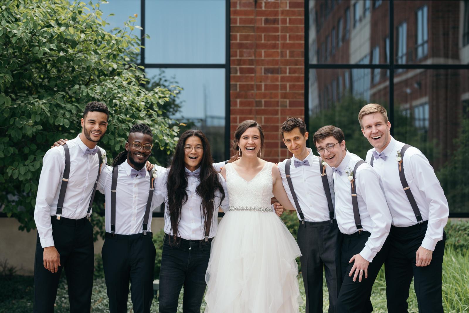 bride with groomsmen Coralville Marriott Hotel Wedding