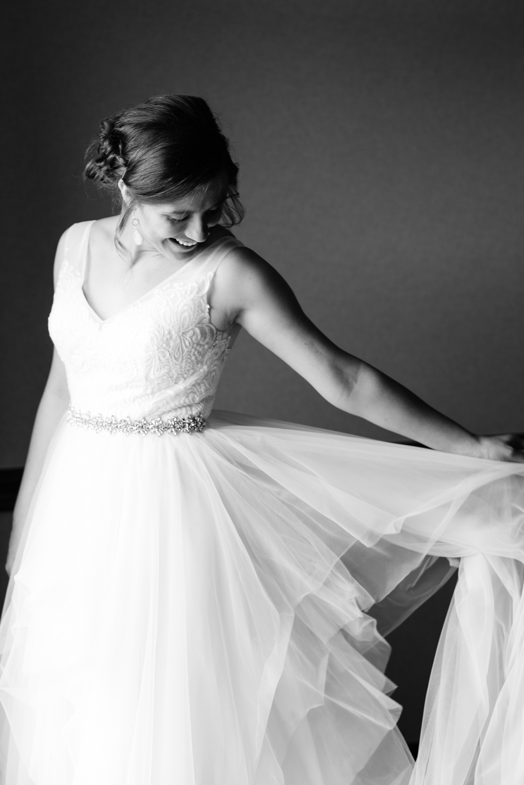 bride playing with wedding dress coralville iowa wedding
