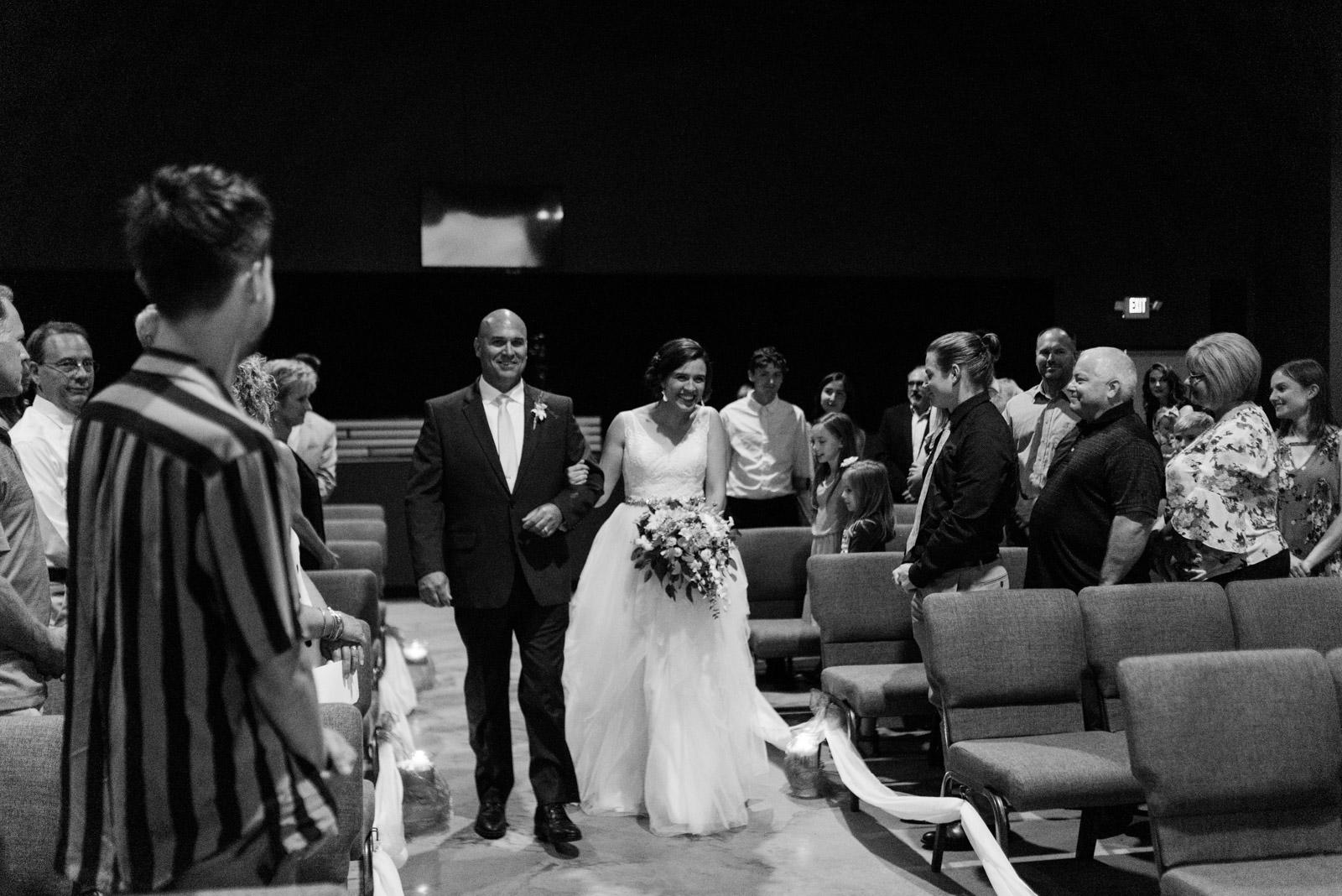 bride walking down aisle veritas church Iowa City wedding ceremony