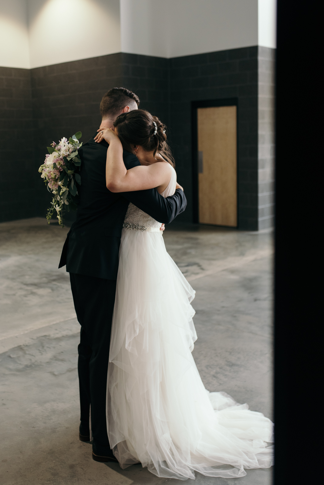 bride and groom hugging veritas church Iowa City wedding