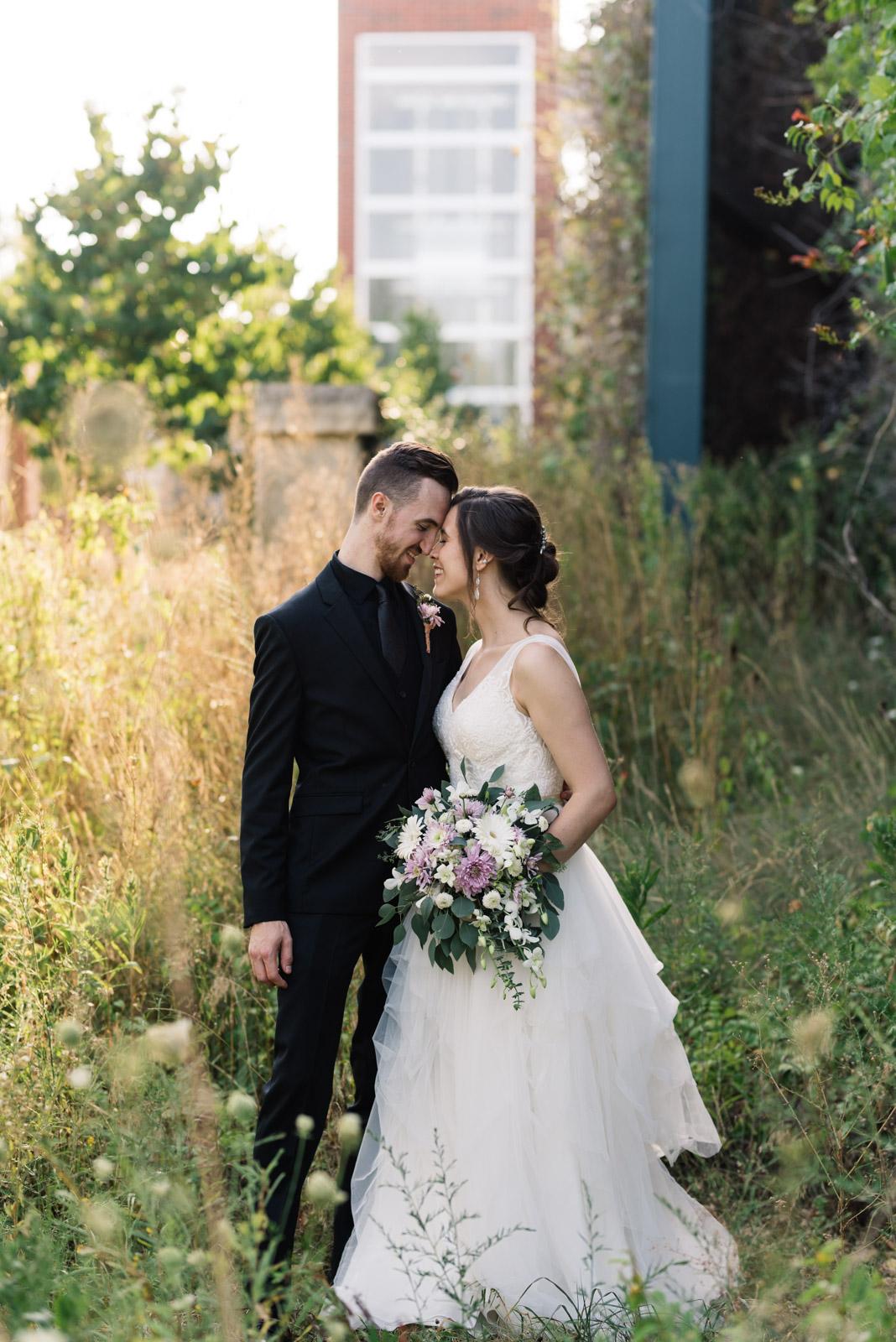 bride and groom cuddling Coralville Marriott Hotel wedding venue
