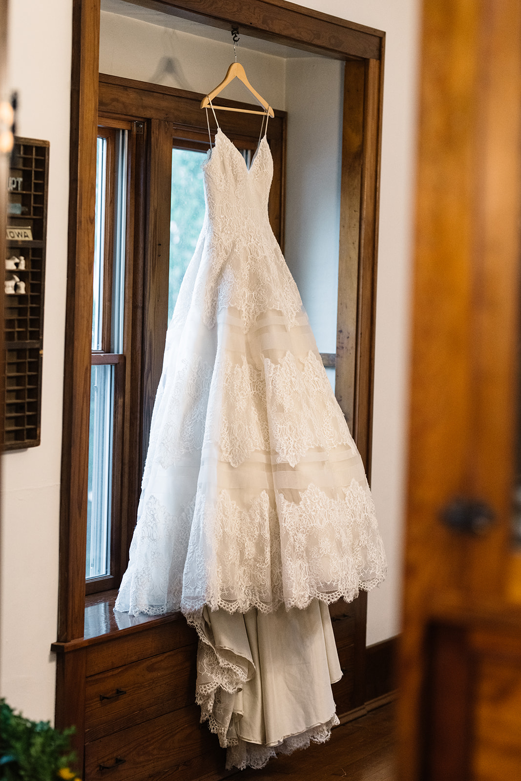 wedding dress hanging in window october iowa wedding