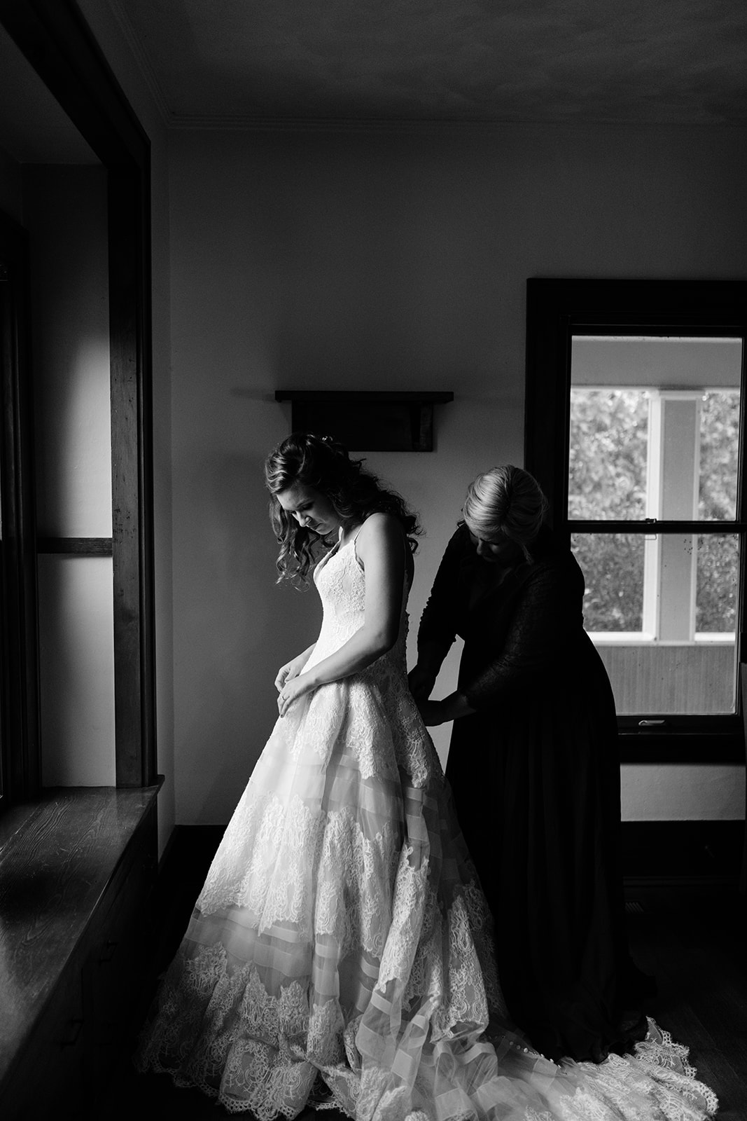 bride getting in wedding dress wellman iowa wedding