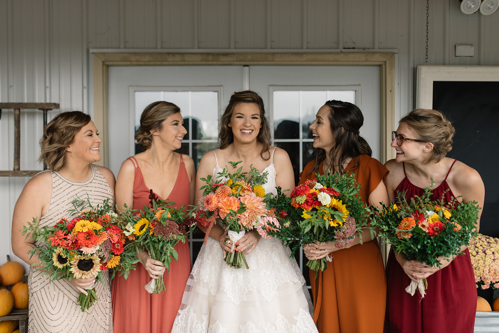 bride and bridesmaids with under a tin roof flower bouquets