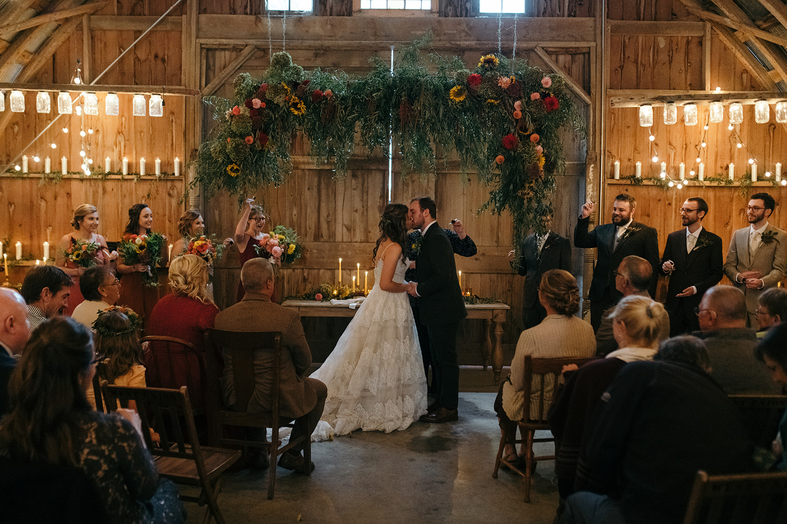 bride and groom first kiss the barn wellman iowa wedding venue