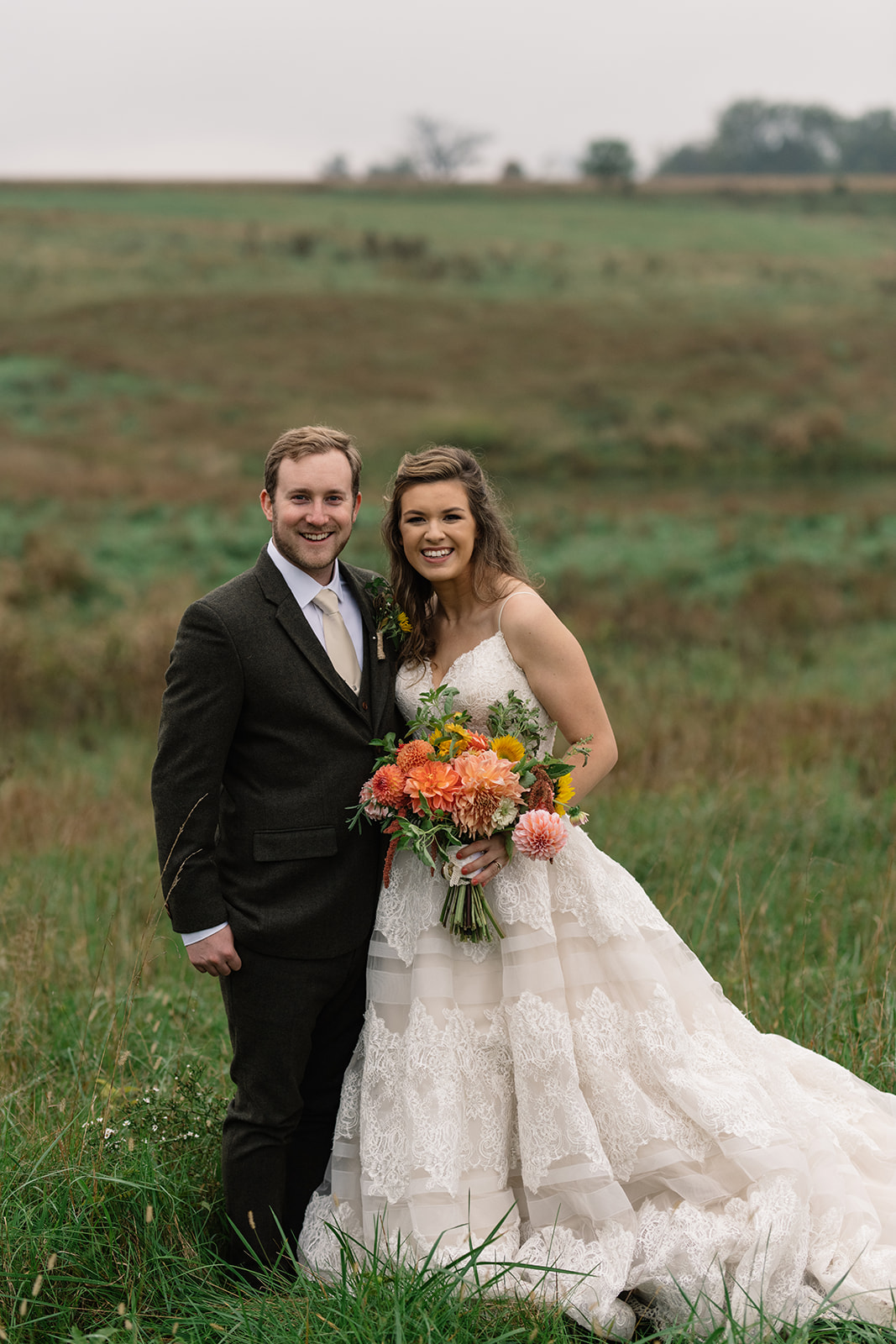 bride and groom in field iowa fall wedding