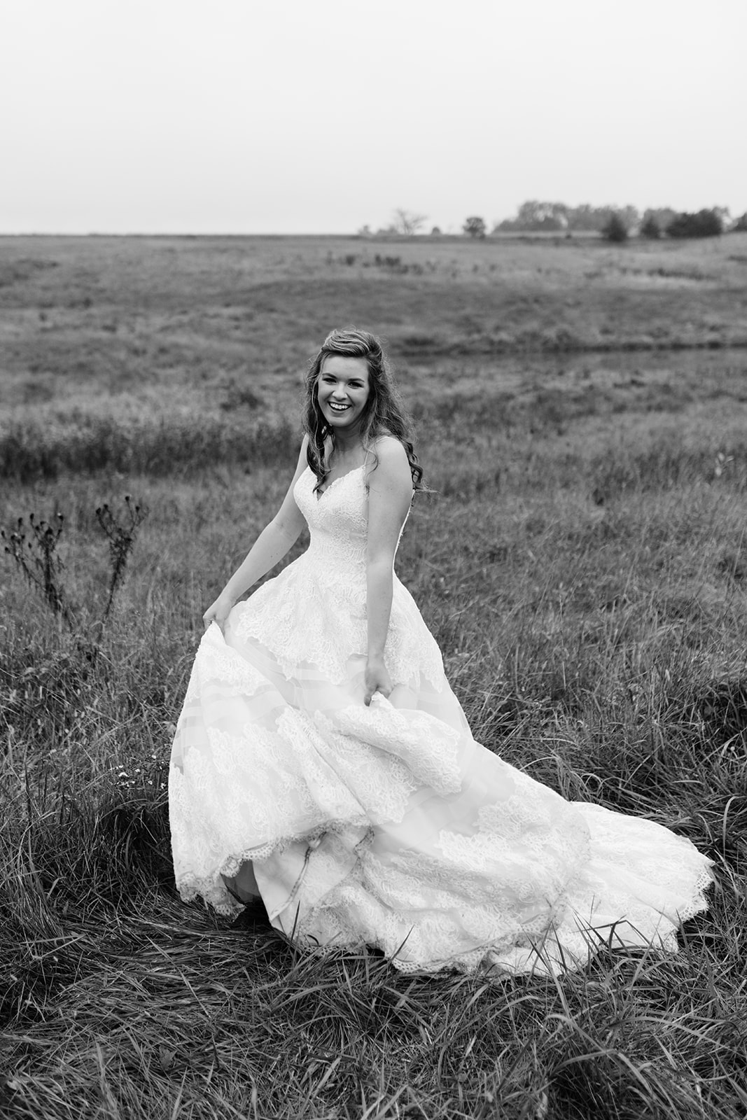 bride in field iowa fall wedding