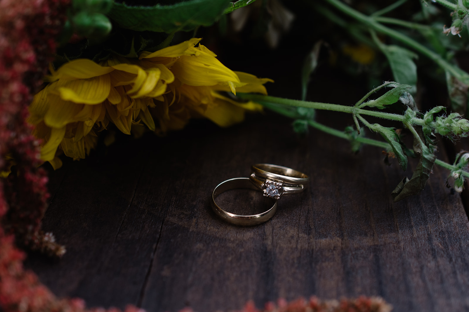 wedding rings with wild flowers under a tin roof wedding